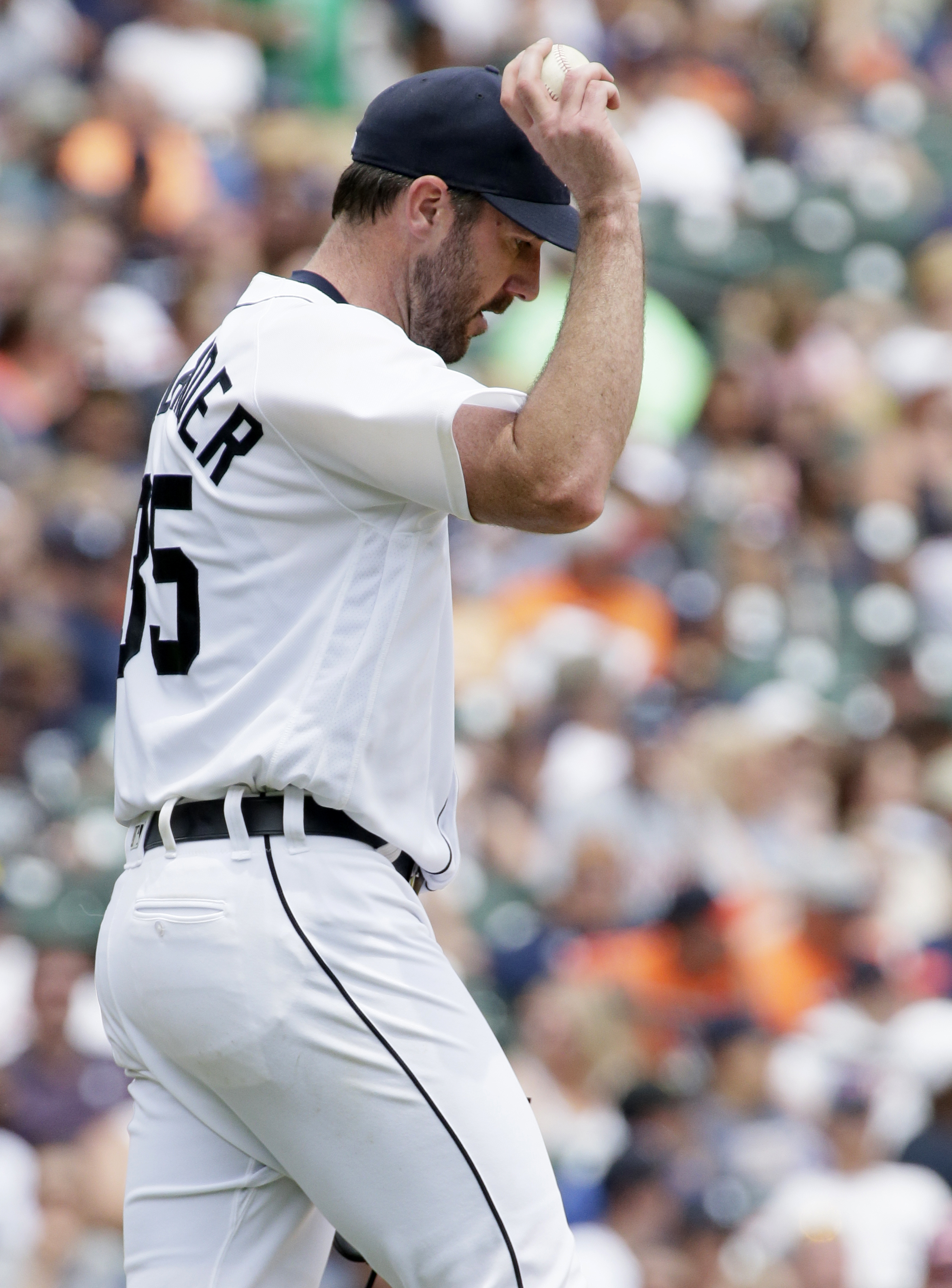 Detroit Tigers' Justin Verlander reacts after giving up a two-run home run to Cleveland Indians' Mike Napoli during the fifth inning of a baseball game Sunday, June 26, 2016, in Detroit. (AP Photo/Duane Burleson)