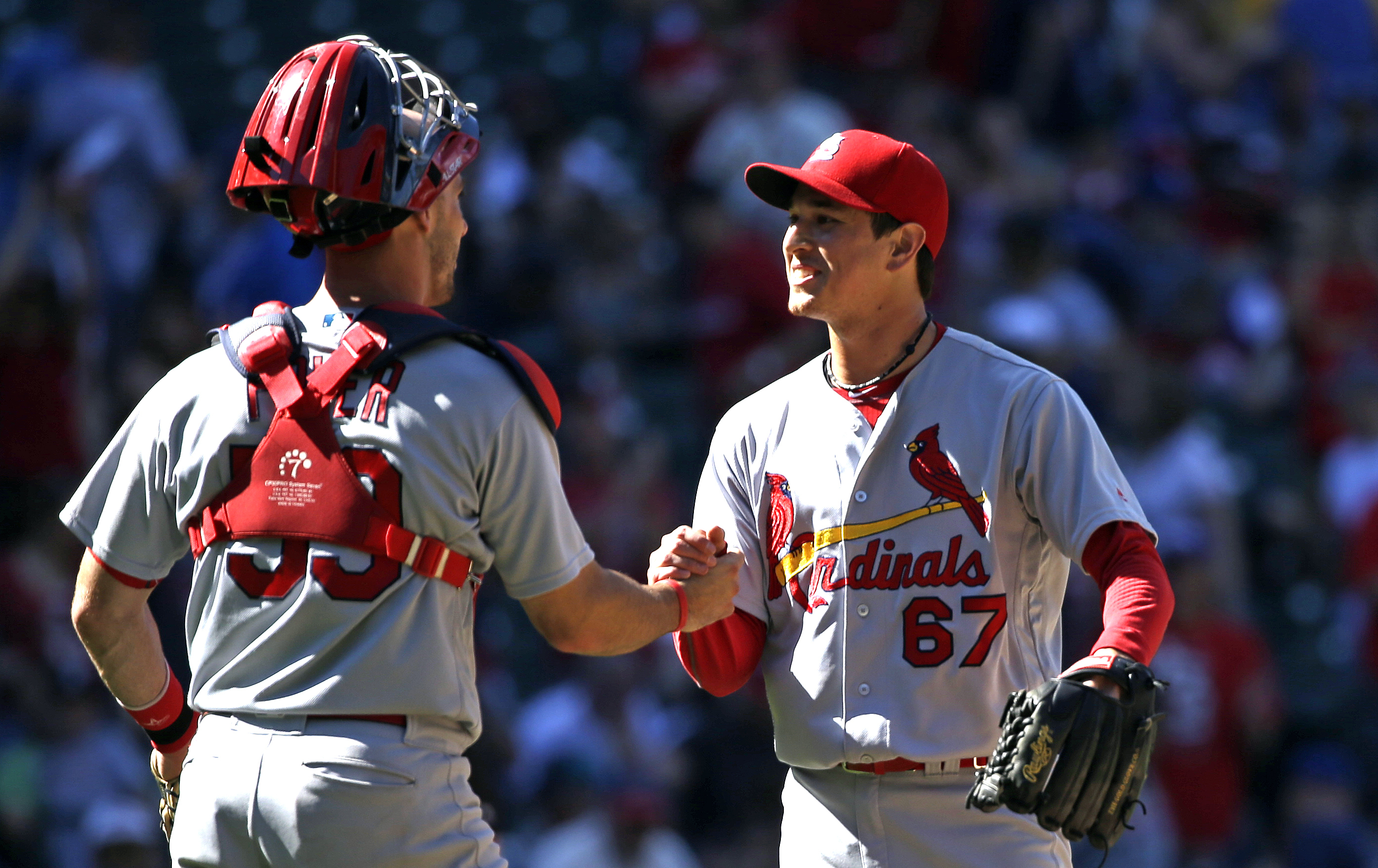 St. Louis Cardinals closing pitcher Matt Bowman (67) and catcher Eric Fryer share congratulations after they defeated the Seattle Mariners in a baseball game Sunday, June 26, 2016, in Seattle. (AP Photo/Elaine Thompson)
