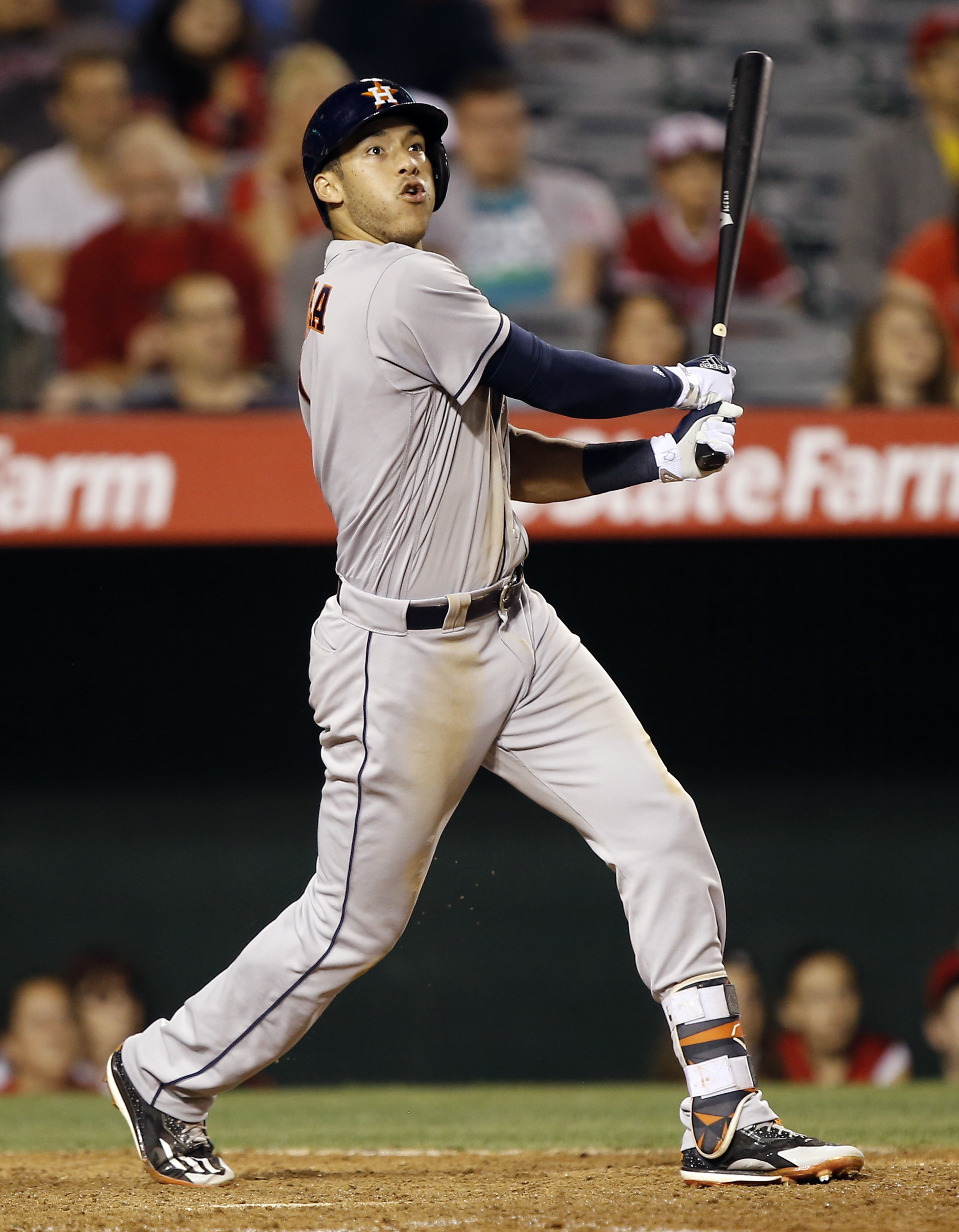 Houston Astros' Carlos Correa hits an RBI sacrifice fly to right field during the ninth inning of a baseball game against the Los Angeles Angels in Anaheim, Calif., Monday, June 27, 2016. (AP Photo/Alex Gallardo)
