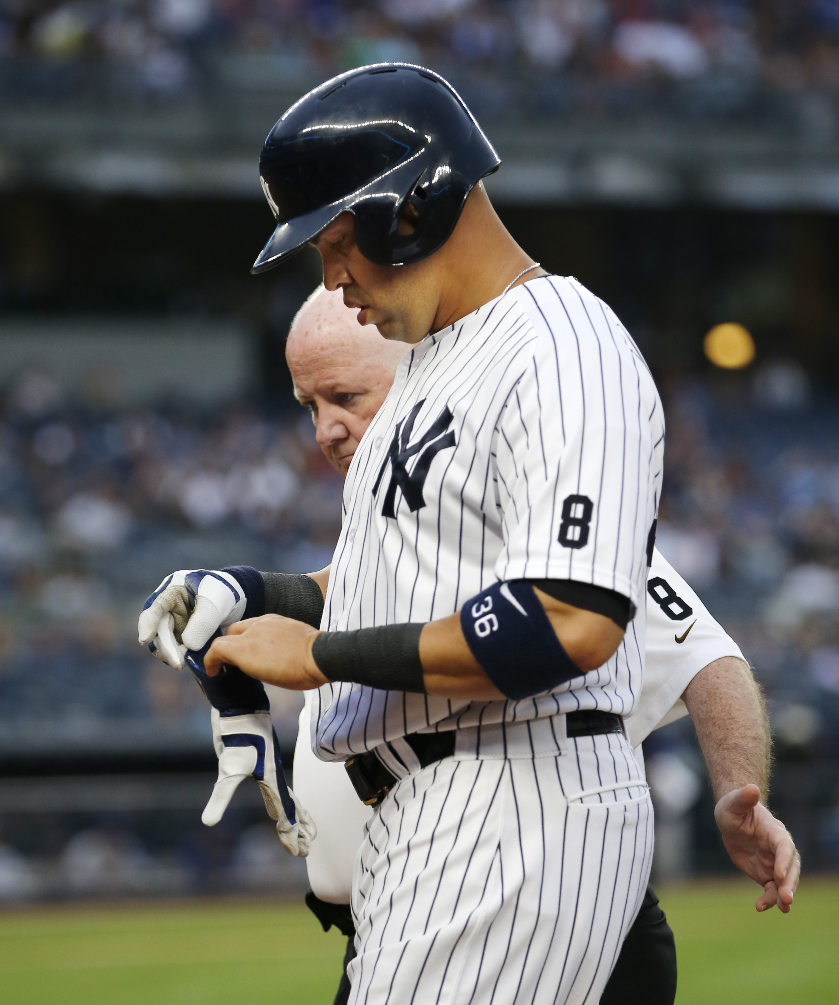 New York Yankees' Carlos Beltran, right, leaves the game with Yankees trainer Steve Donohue with an injury during the first inning of a baseball game against the Texas Rangers, in New York, Tuesday, June 28, 2016. (AP Photo/Kathy Willens)