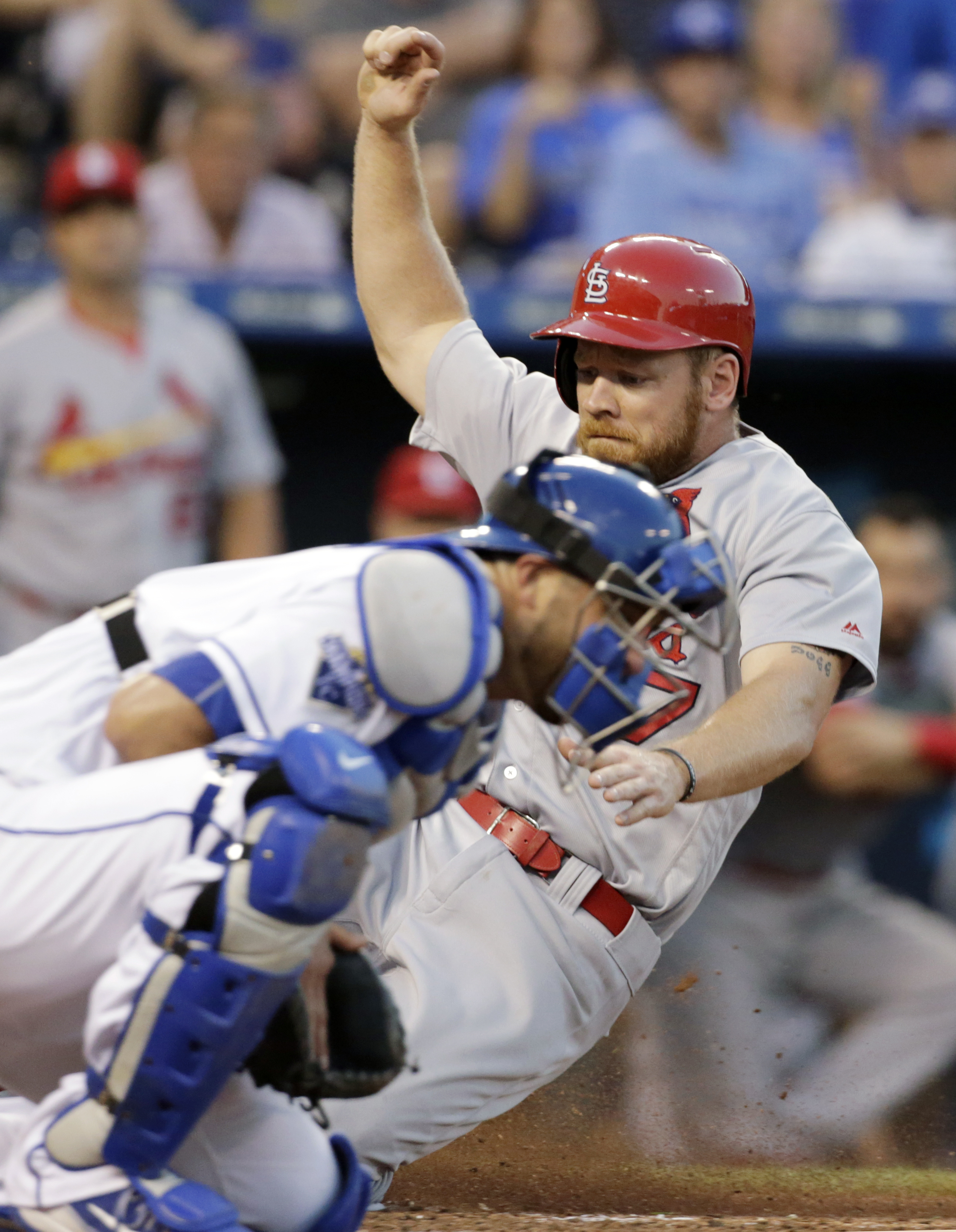 St. Louis Cardinals Brandon Moss (37) is safe at home plate as Kansas City Royals catcher Drew Butera (9) gets a late throw in the fifth inning of a baseball game in Kansas City, Mo., Tuesday, June 28, 2016. (AP Photo/Colin E. Braley)