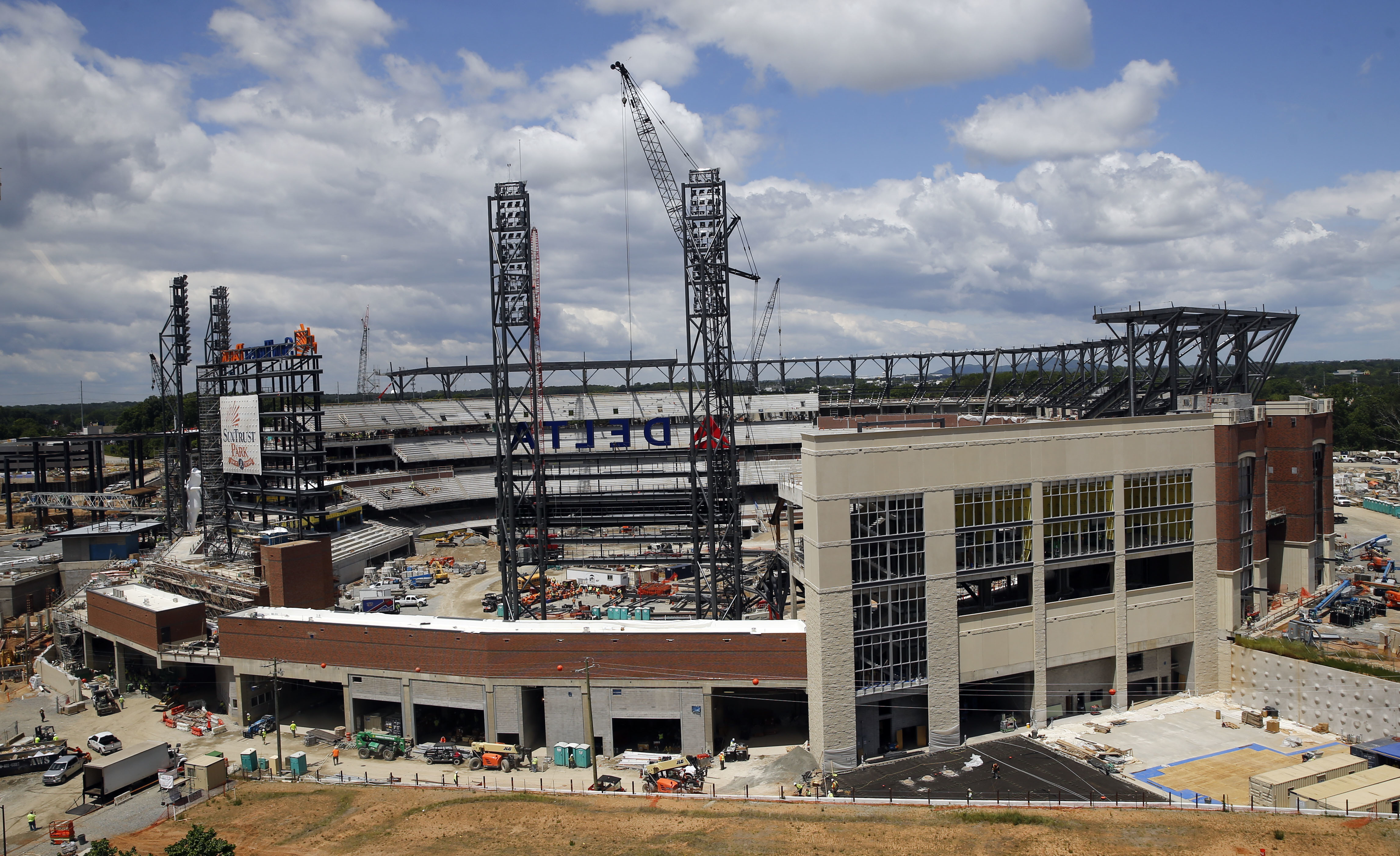 FILE- In this May 5, 2016, file photo, work continues on SunTrust Park, the future home of the Atlanta Braves baseball team in Atlanta. The Braves are scheduled to open SunTrust Park in April 2017, according to a copy of the team's preliminary schedule ob