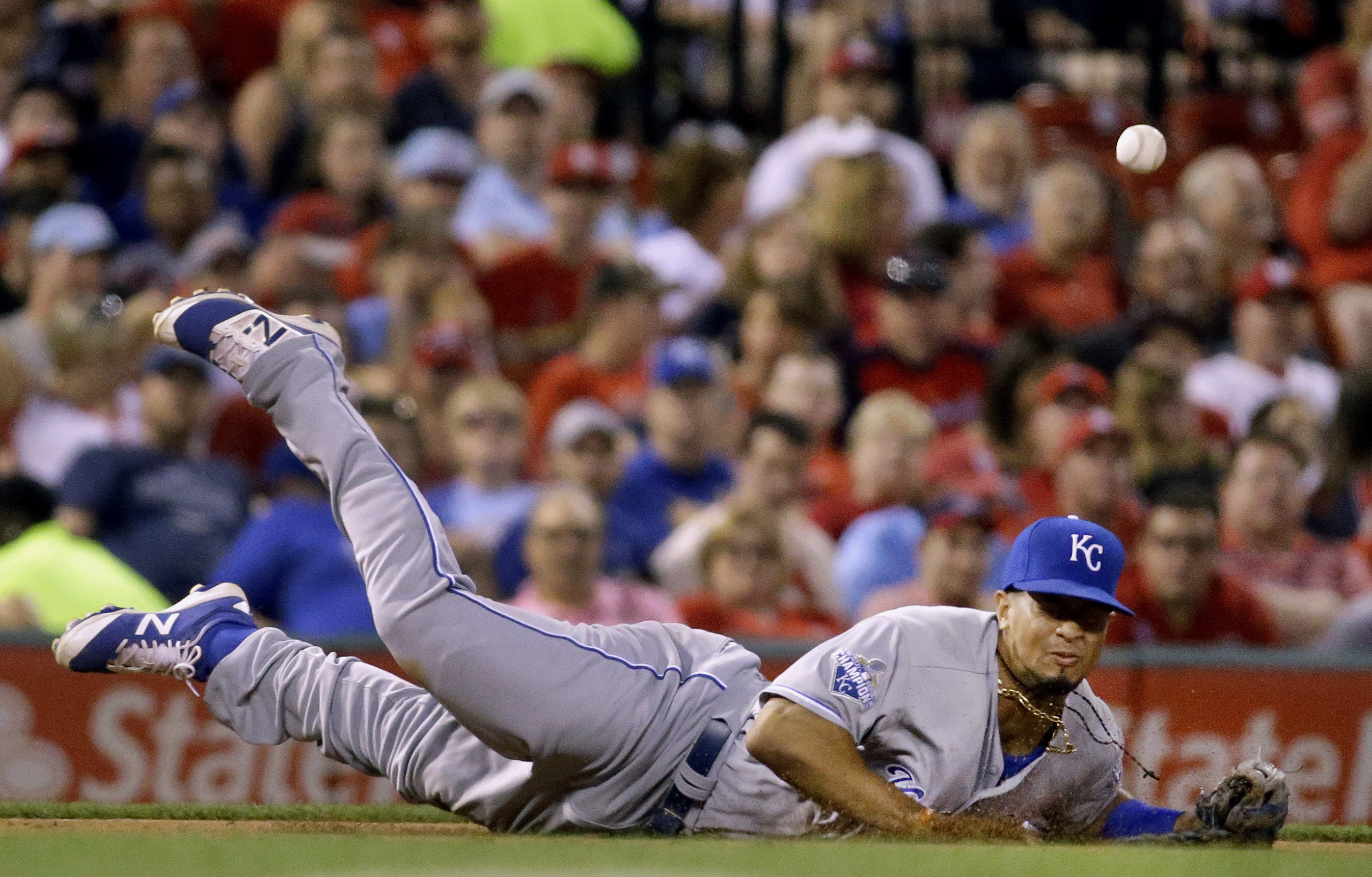 Kansas City Royals third baseman Cheslor Cuthbert dives but is unable to catch a single hit by St. Louis Cardinals' Jhonny Peralta during the fifth inning of a baseball game Wednesday, June 29, 2016, in St. Louis. (AP Photo/Jeff Roberson)