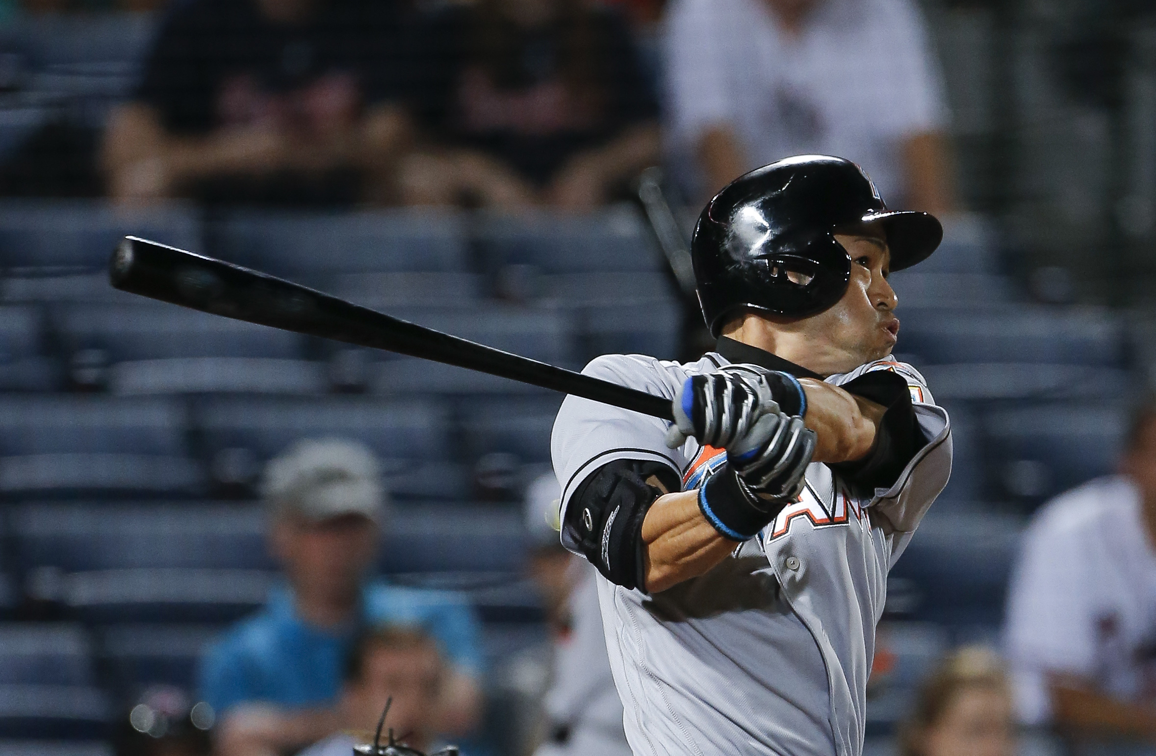 Miami Marlins pinch hitter Ichiro Suzuki (51) flies out to center in the eighth inning of a baseball game against the Atlanta Braves, Thursday, June 30, 2016, in Atlanta. (AP Photo/John Bazemore)