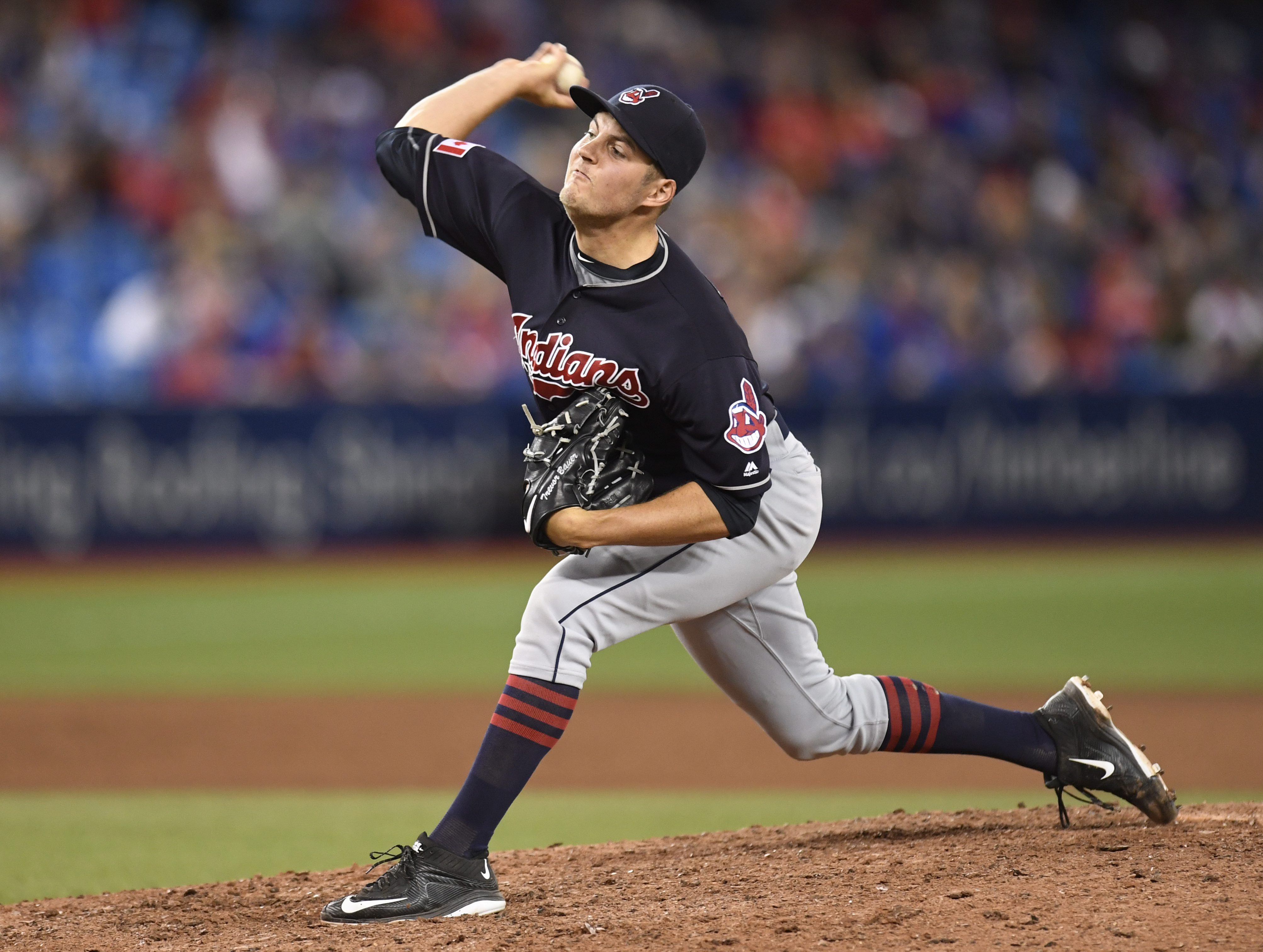 Cleveland Indians pitcher Trevor Bauer pitches against the Toronto Blue Jays during the 15th inning of a baseball game in Toronto, Friday, July 1, 2016. (Frank Gunn/The Canadian Press via AP)