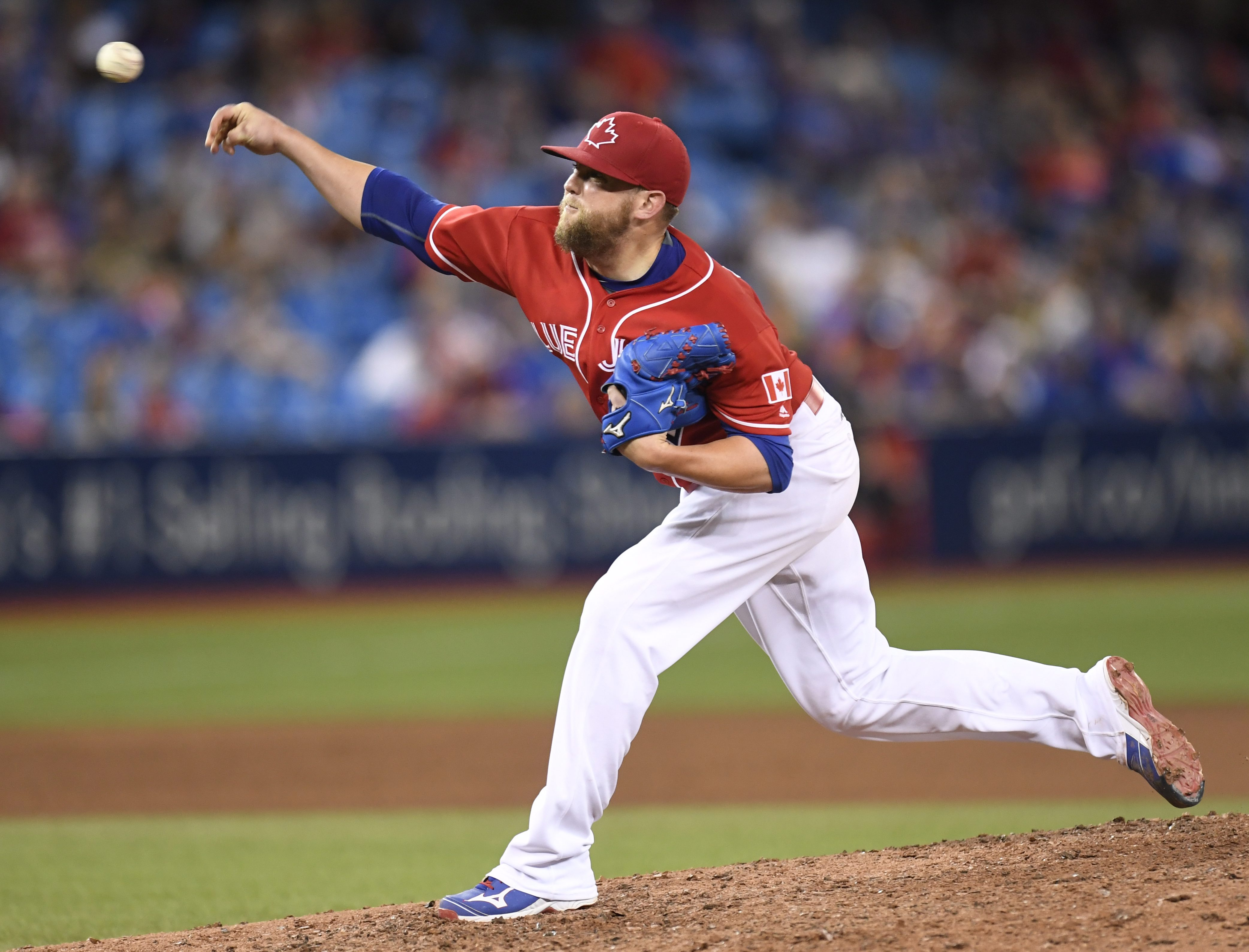 Toronto Blue Jays pitcher Drew Storen pitches against the Cleveland Indians during 15th inning of a baseball game in Toronto, Friday, July 1, 2016. (Frank Gunn/The Canadian Press via AP)