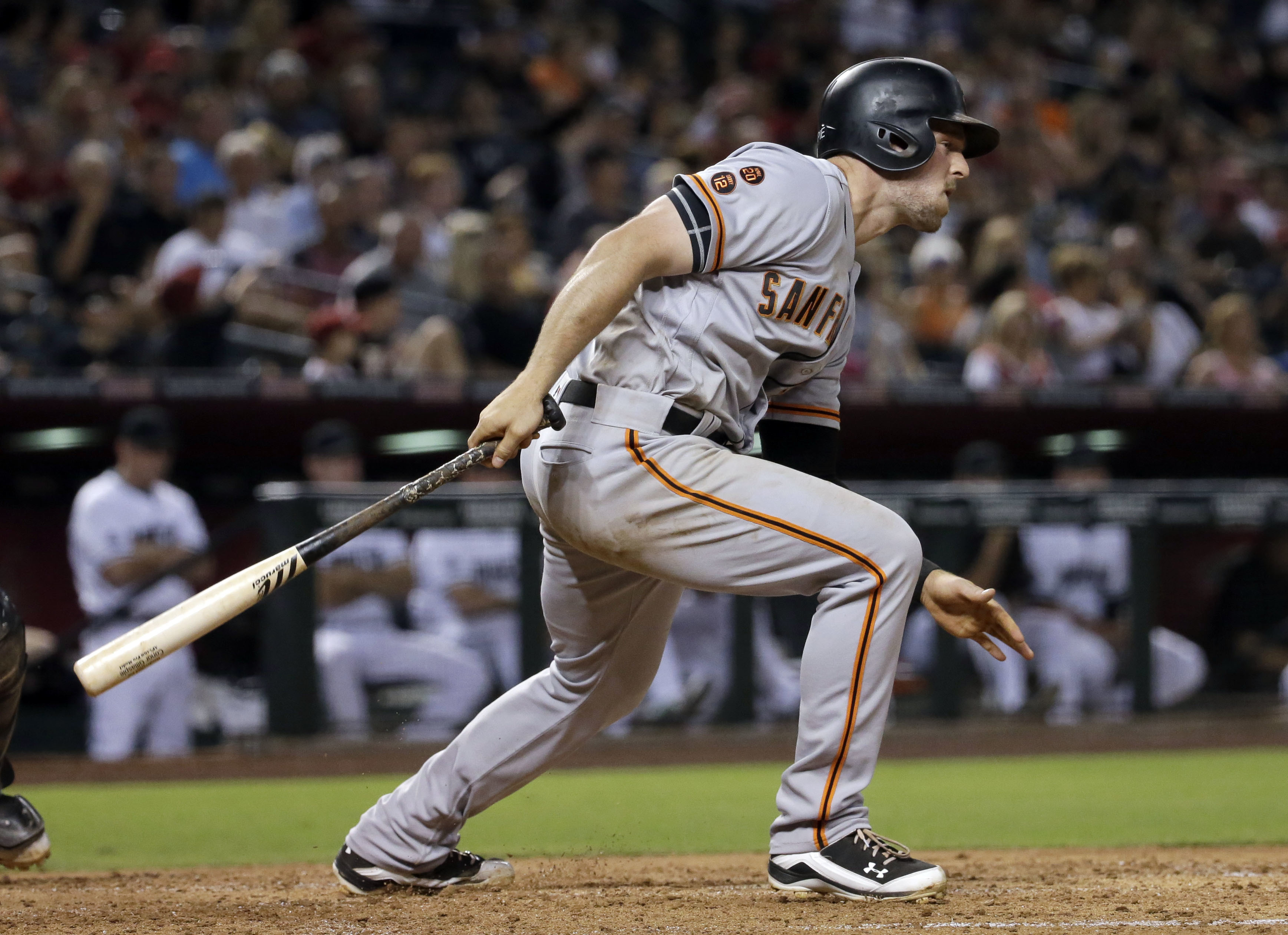 San Francisco Giants' Conor Gillaspie follows through on his third hit of the night against the Arizona Diamondbacks during the sixth inning of a baseball game, Friday, July 1, 2016, in Phoenix. (AP Photo/Matt York)