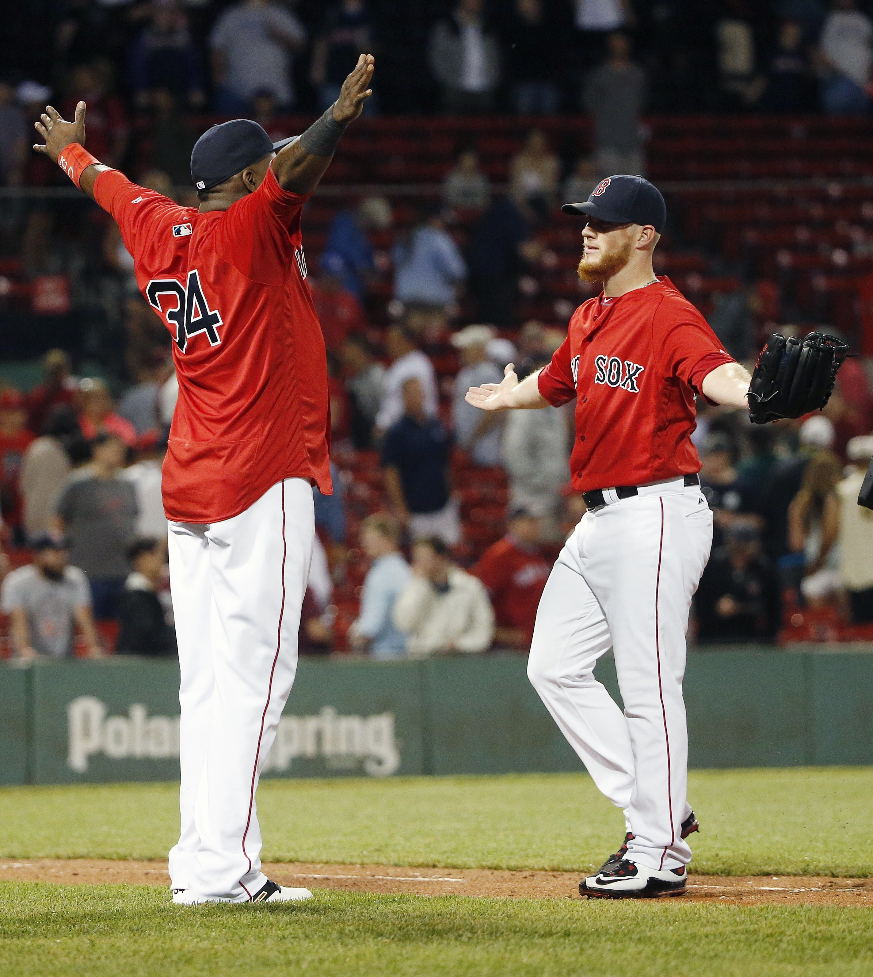 Boston Red Sox's David Ortiz (34) and Craig Kimbrel celebrate after the Red Sox defeated the Los Angeles Angels 5-4 during a baseball game in Boston, early Saturday, July 2, 2016. (AP Photo/Michael Dwyer)