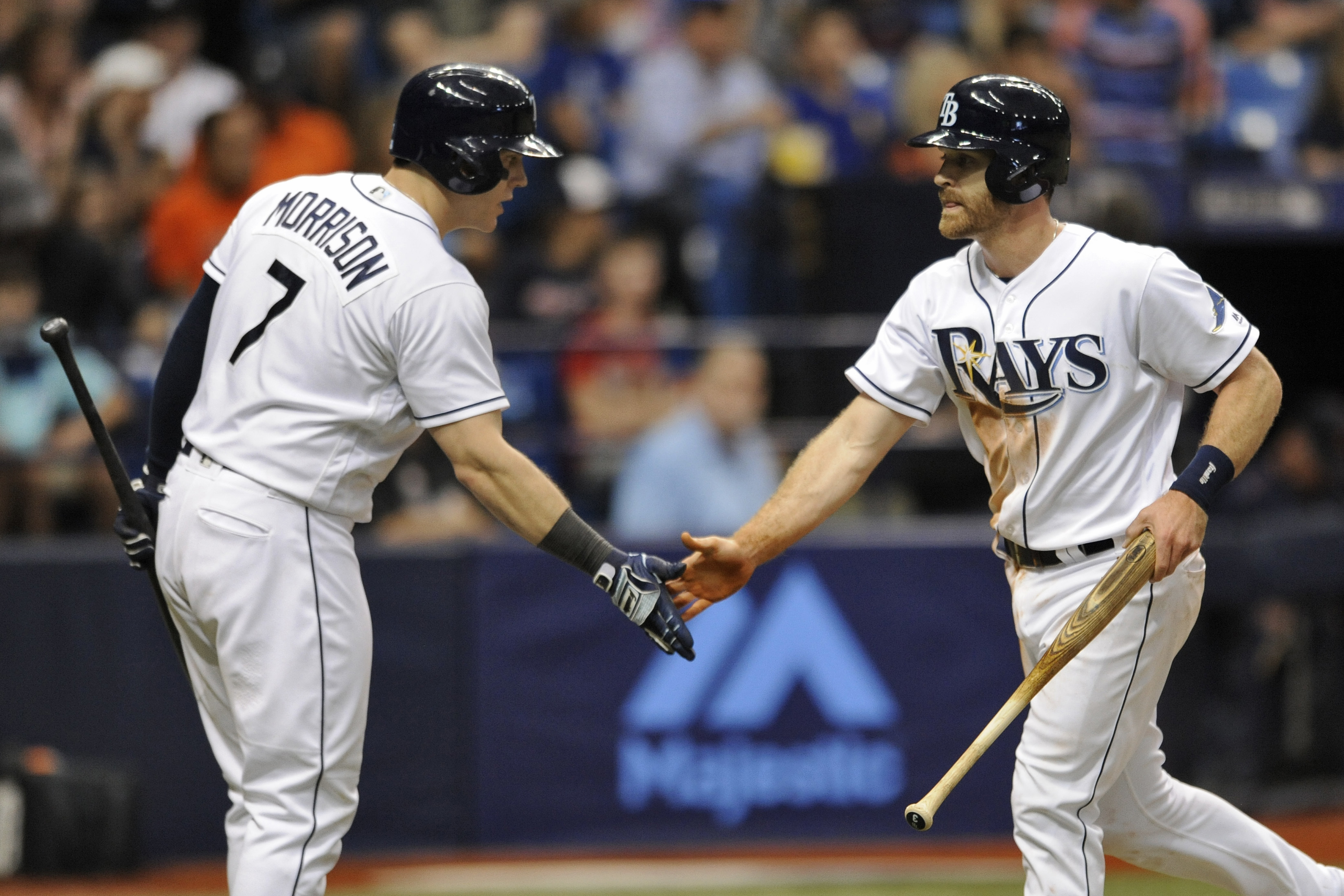 Tampa Bay Rays on-deck hitter Logan Morrison, left, greets Logan Forsythe, right, after Forsythe scored on Evan Longoria's sacrifice fly to left field during the fourth inning of a baseball game against the Detroit Tigers, Saturday, July 2, 2016, in St. P