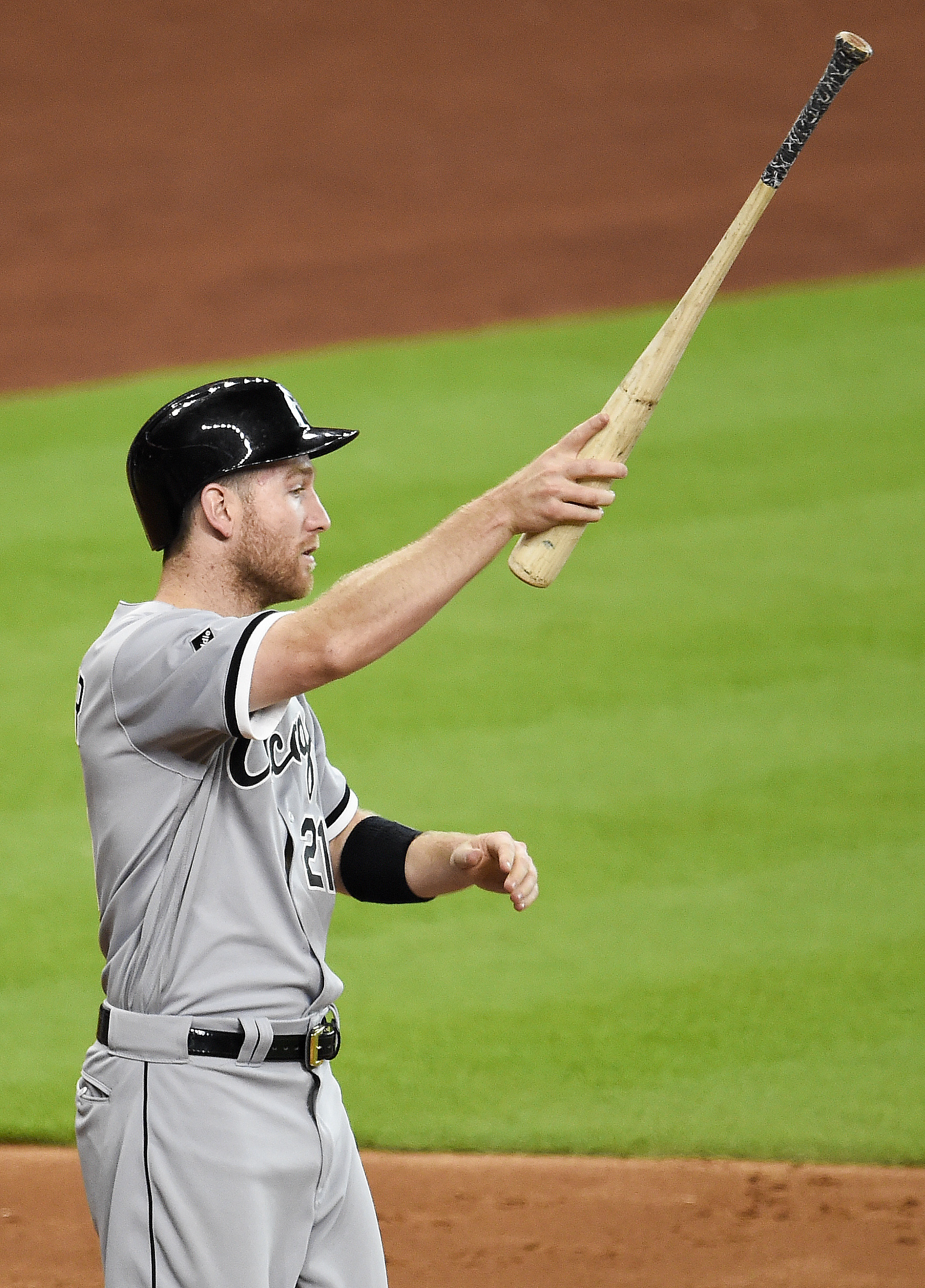 Chicago White Sox's Todd Frazier signals to teammate Dioner Navarro after scoring on Navarro's two-run single in the fifth inning of a baseball game against the Houston Astros, Saturday, July 2, 2016, in Houston. (AP Photo/Eric Christian Smith)