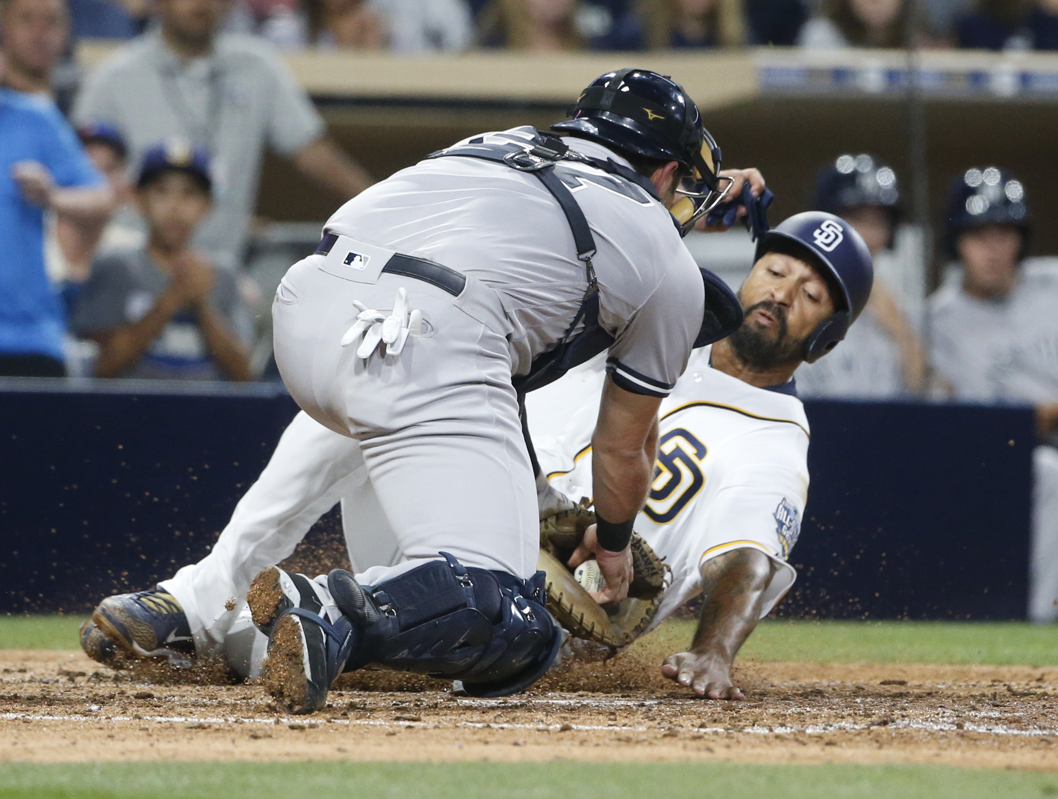 San Diego Padres' Matt Kemp is tagged out by New York Yankees catcher Austin Romine during the sixth inning of a baseball game Saturday, July 2, 2016, in San Diego. (AP Photo/Lenny Ignelzi)