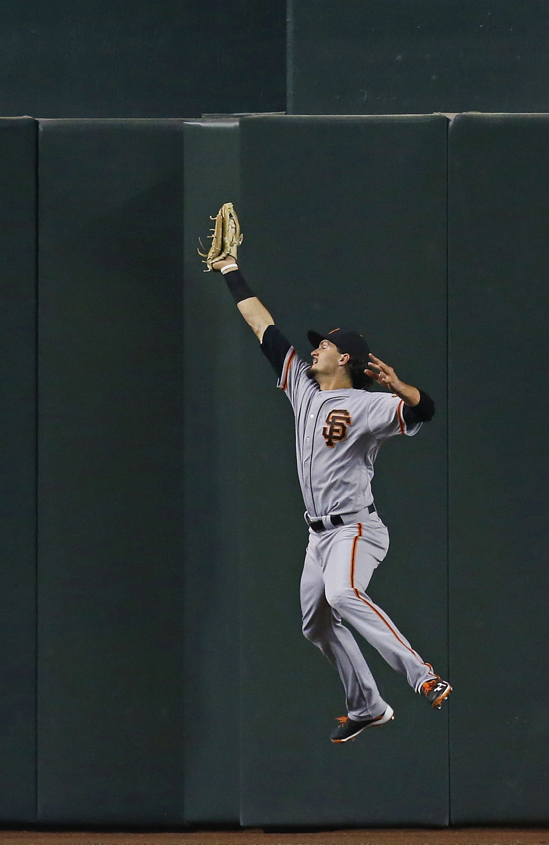San Francisco Giants' Jarrett Parker makes a leaping catch on a fly ball hit by Arizona Diamondbacks' Jake Lamb during the sixth inning of a baseball game Sunday, July 3, 2016, in Phoenix. (AP Photo/Ross D. Franklin)
