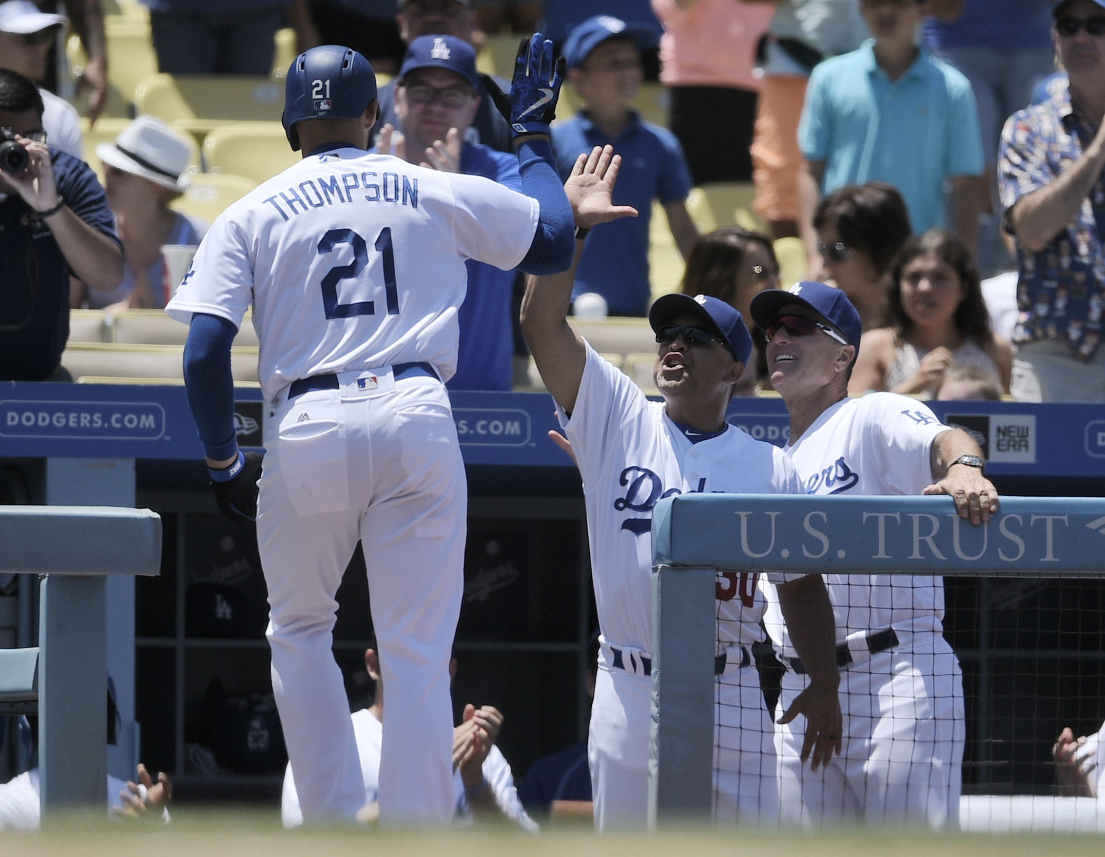 Los Angeles Dodgers' Trayce Thompson, left, celebrates with manager Dave Roberts, center, after he scores off a solo home run as bench coach Bob Geren, right, looks during the second inning of a baseball game against the Colorado Rockies in Los Angeles, S
