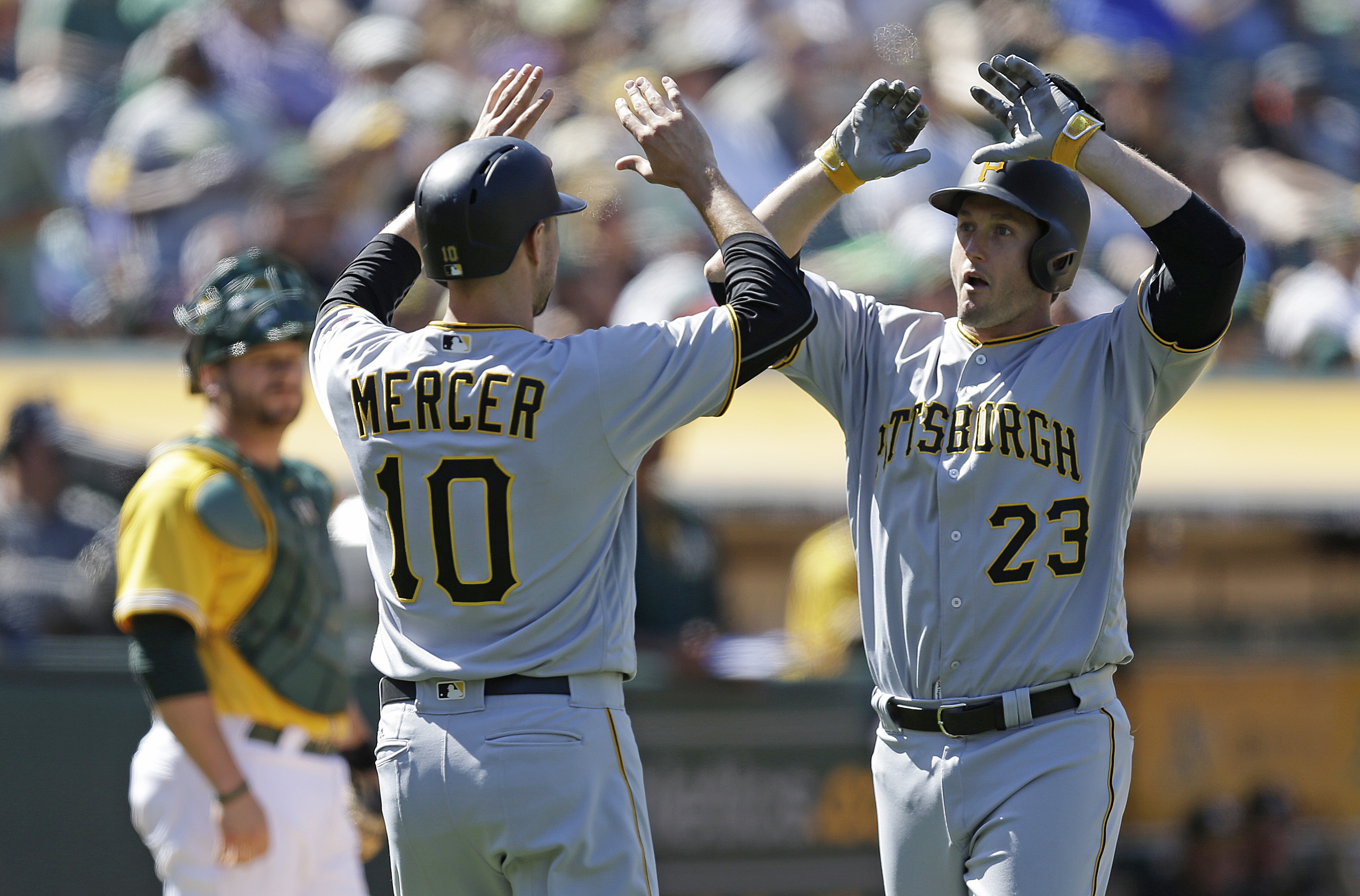 Pittsburgh Pirates' David Freese, right, celebrates with Jordy Mercer (10) after hitting a two-run home run off Oakland Athletics' John Axford in the eighth inning of a baseball game Sunday, July 3, 2016, in Oakland, Calif. (AP Photo/Ben Margot)