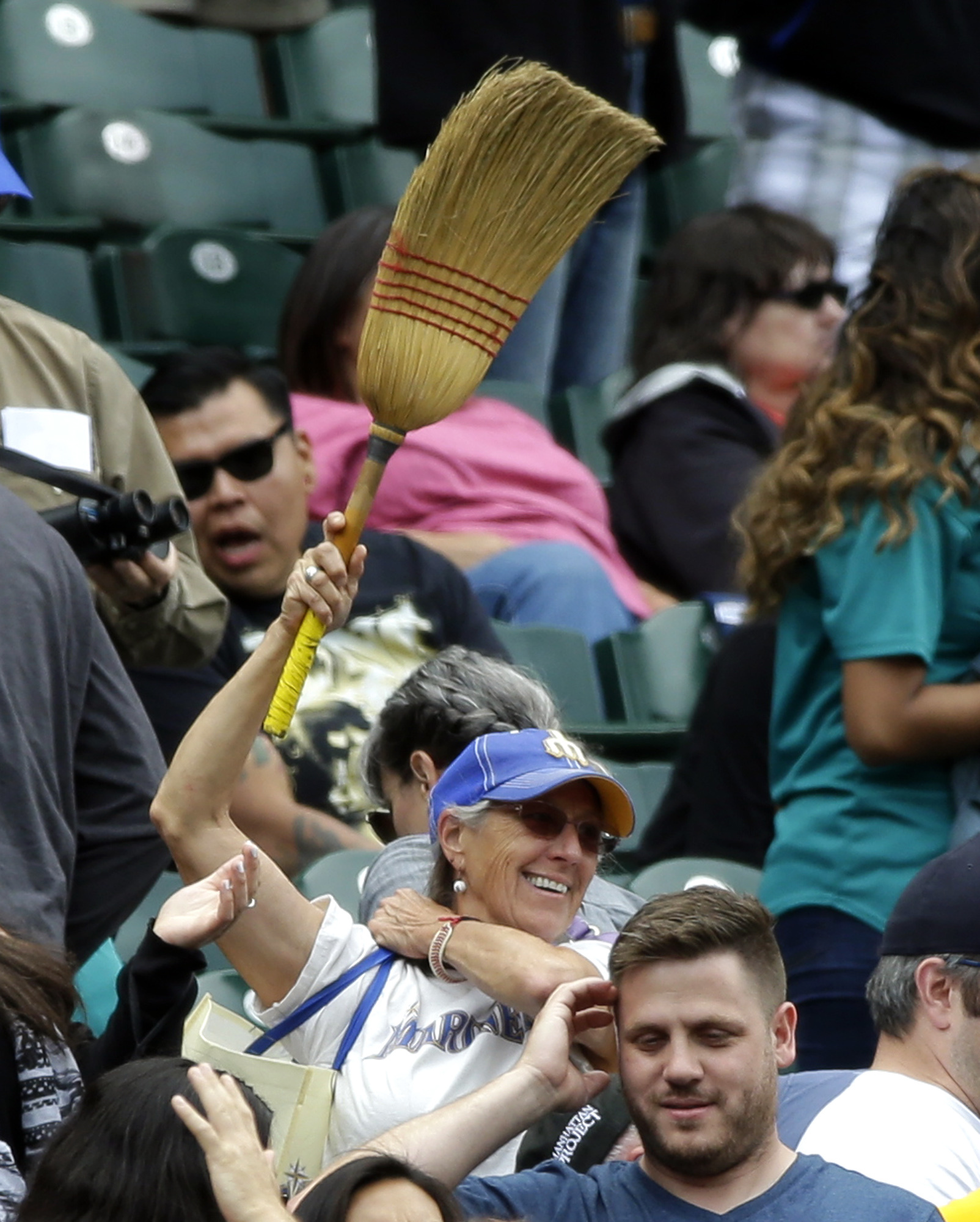 A Seattle Mariners fan waves a broom in the stands during the ninth inning of the Mariners 9-4 win over the Baltimore Orioles in a baseball game, Sunday, July 3, 2016, in Seattle. The Mariners swept the four-game home series against the Orioles. (AP Photo