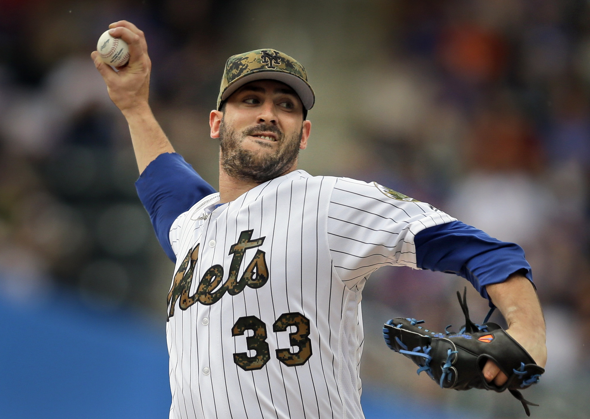 FILE - In this May 30, 2016, file photo, New York Mets starting pitcher Matt Harvey throws during the first inning of a baseball game against the Chicago White Sox in New York. Harvey (4-10) starts Monday, July 4, 2016, for the Mets against the Miami Marl