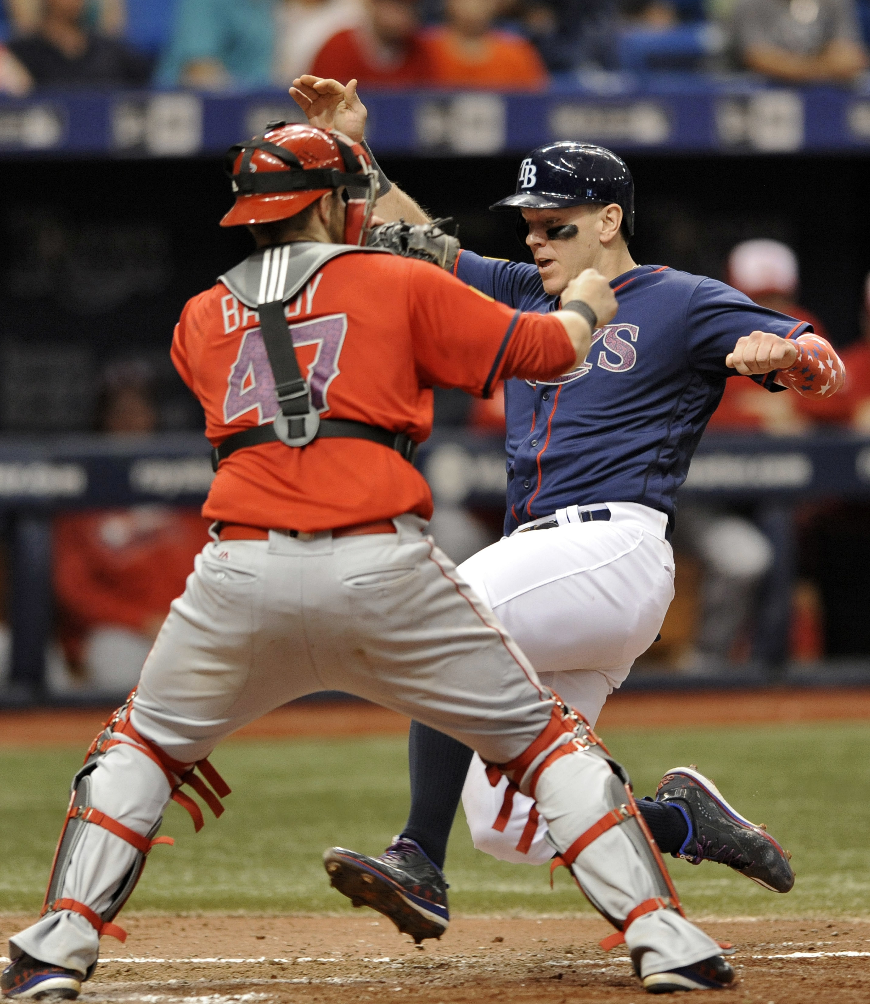 Los Angeles Angels catcher Jett Bandy (47) waits for the throw as Tampa Bay Rays' Logan Morrison, right, scores on a Steven Souza Jr. double off Los Angeles reliever Fernando Salas during the sixth inning of a baseball game Monday, July 4, 2016, in St. Pe