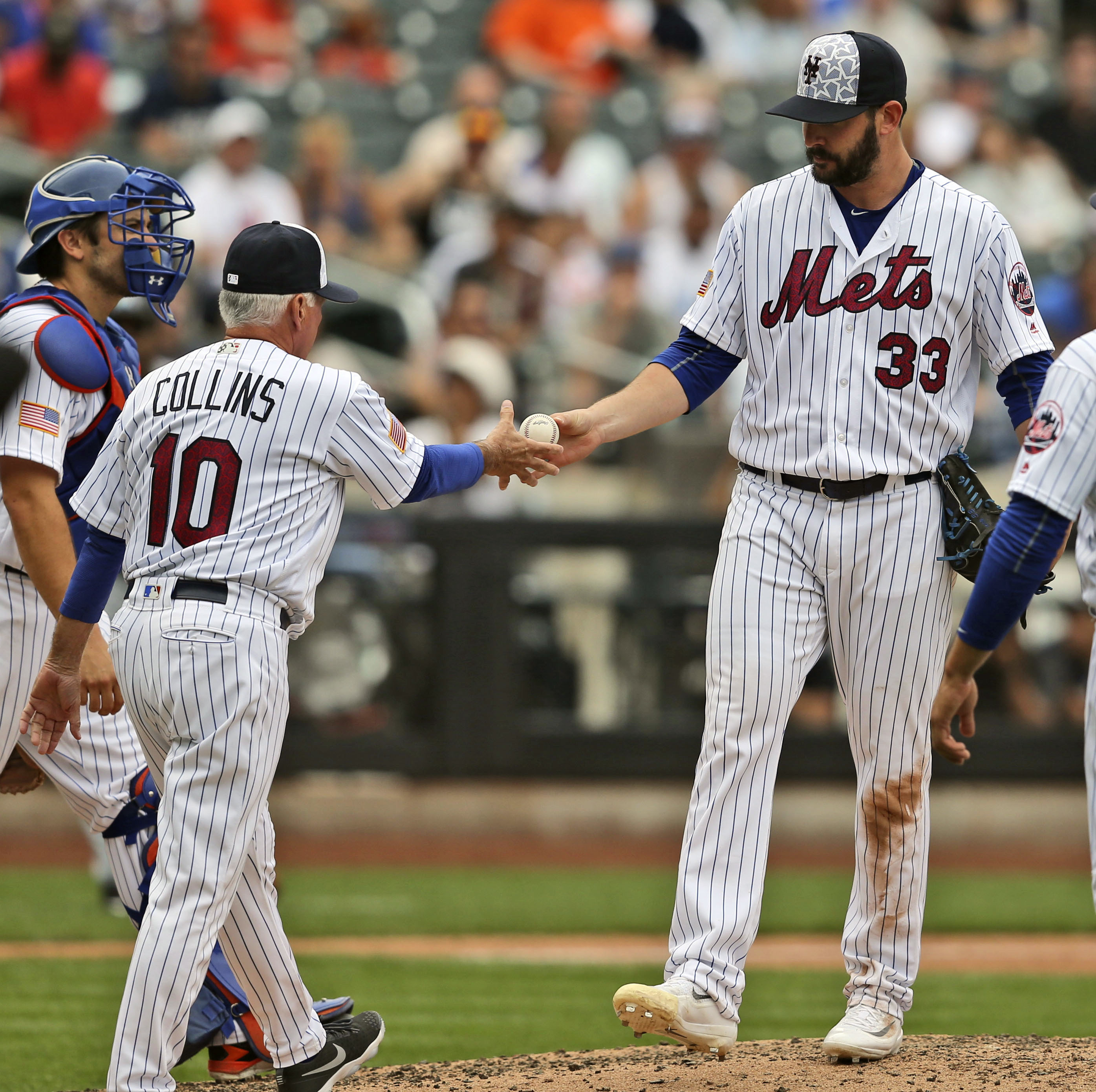 New York Mets manager Terry Collins, left, pulls pitcher Matt Harvey from a baseball game during the fourth inning against the Miami Marlins, Monday, July 4, 2016, in New York. (AP Photo/Seth Wenig)