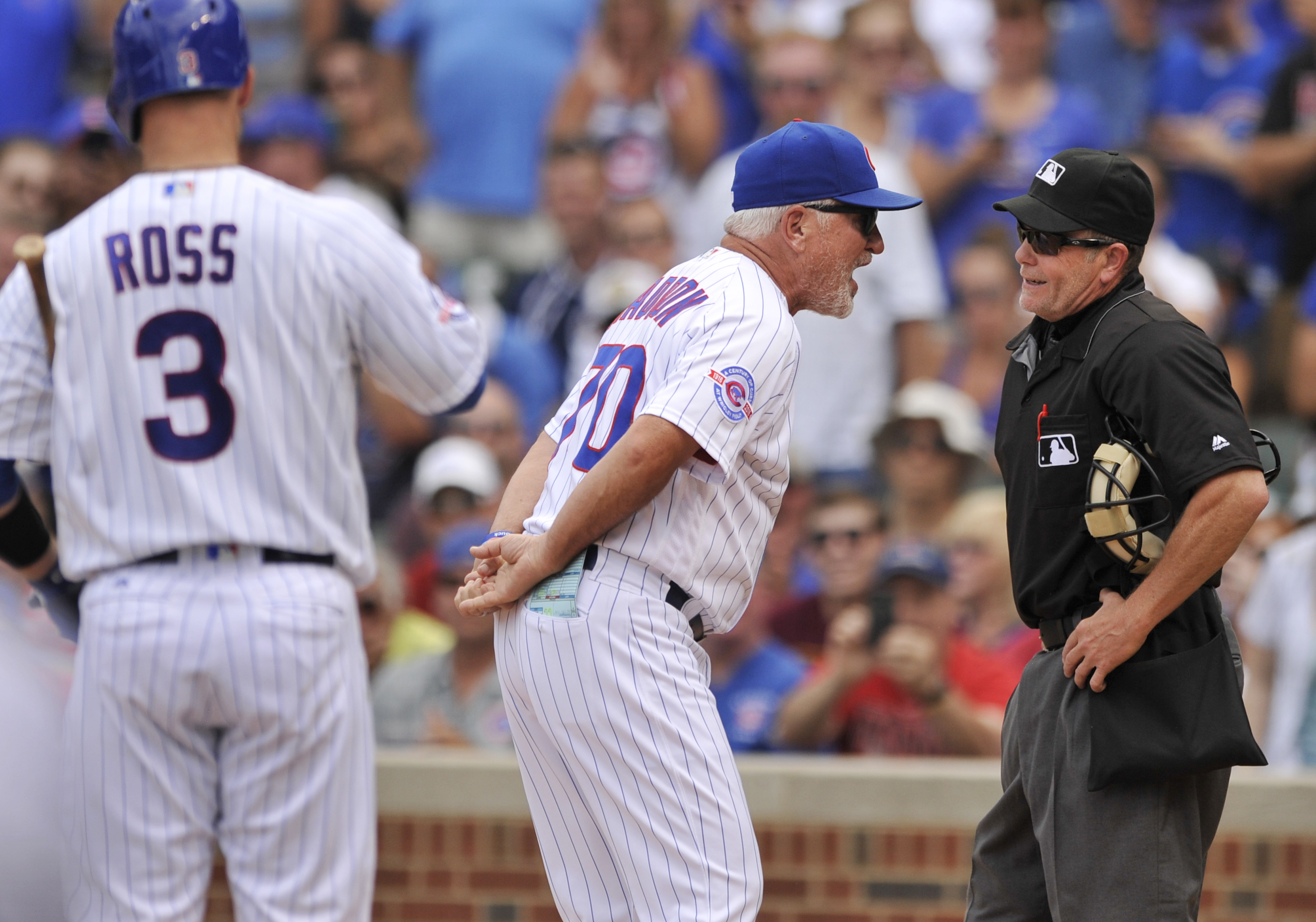 Chicago Cubs manager Joe Maddon (70) argues with home plate umpire Jerry Meals after Meals ejected Maddon for arguing a strike call on Chicago Cubs' David Ross (3) during the second inning of a baseball game against the Cincinnati Reds Tuesday, July 5, 20