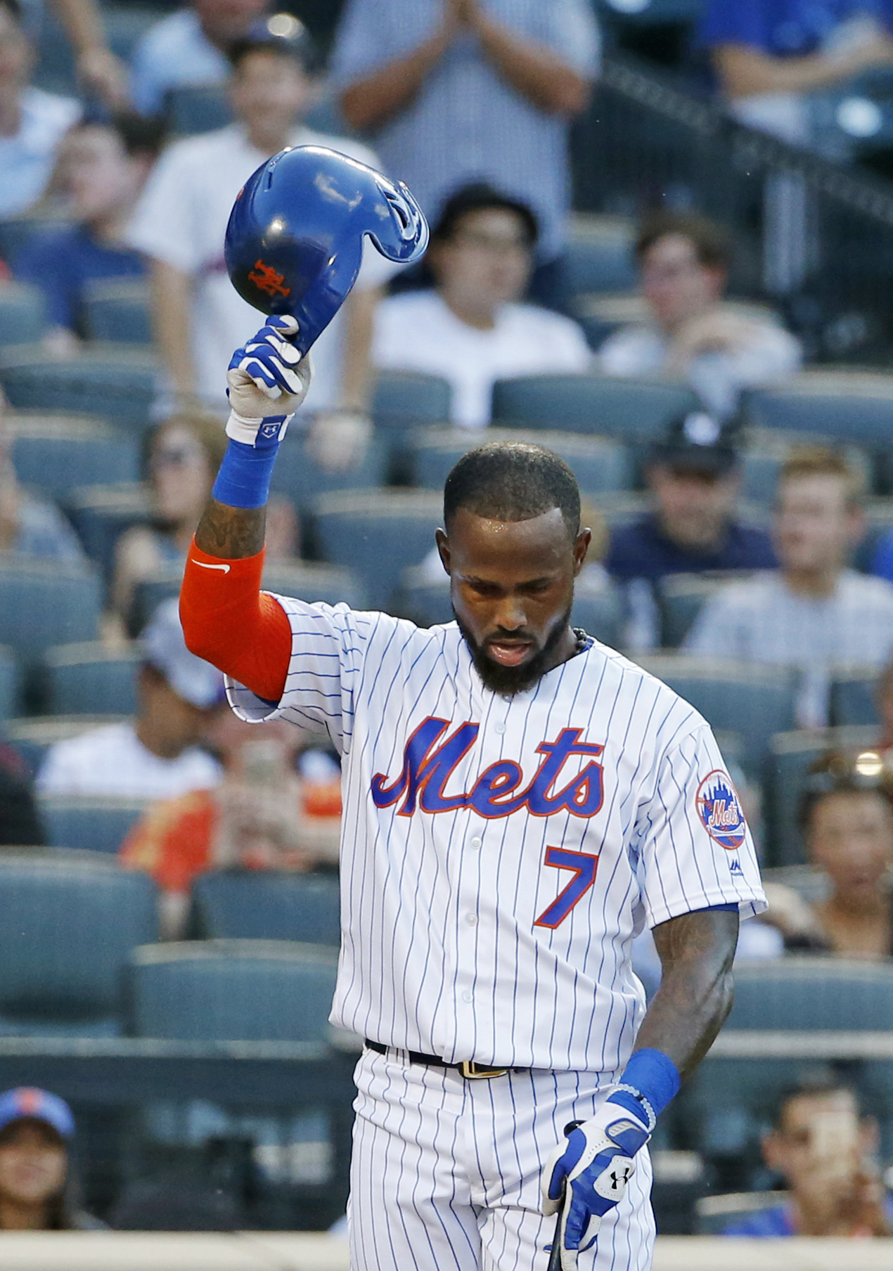 New York Mets Jose Reyes tips his cap before his first at-bat after returning to the Mets, his first team, during a baseball game against the Miami Marlins, Tuesday, July 5, 2016, in New York. Reyes served a suspension under the league's domestic violence