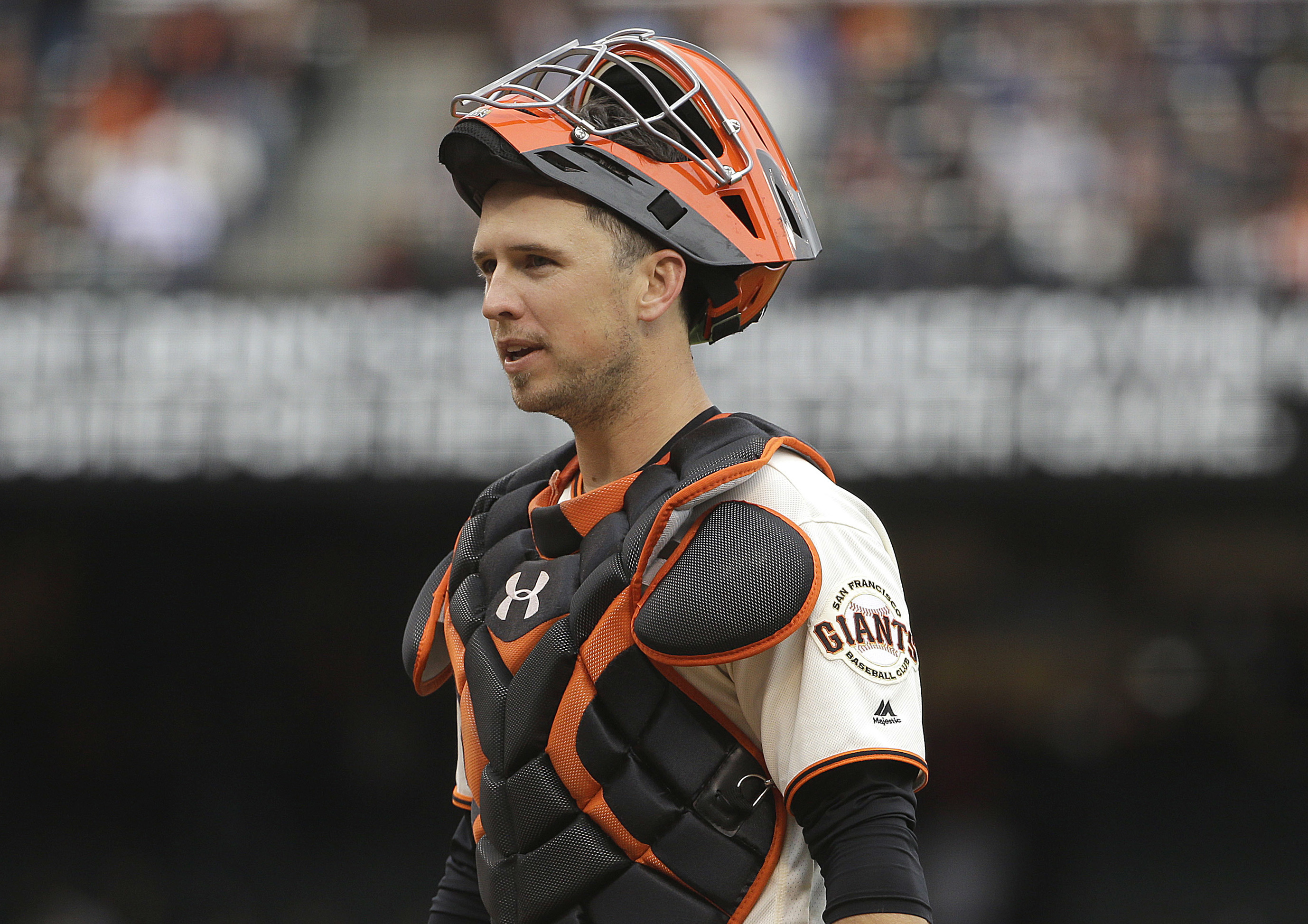 FILE - In this April 9, 2016, file photo, San Francisco Giants catcher Buster Posey pauses during the team's baseball game against the Los Angeles Dodgers in San Francisco. Posey was named starting catcher for the All-Star Game, in voting by fans announce