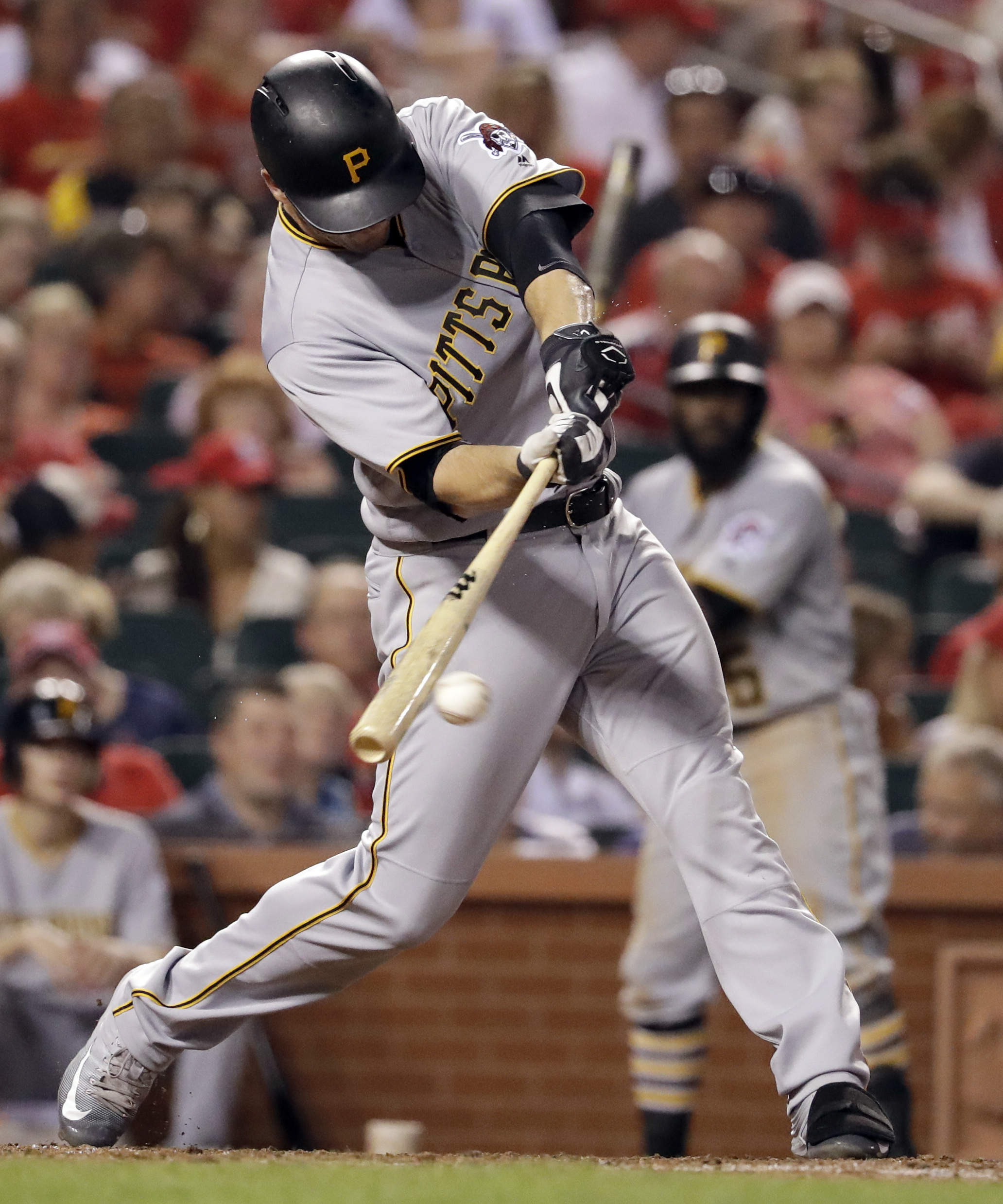 Pittsburgh Pirates' David Freese hits an RBI single during the sixth inning of a baseball game against the St. Louis Cardinals on Tuesday, July 5, 2016, in St. Louis. (AP Photo/Jeff Roberson)