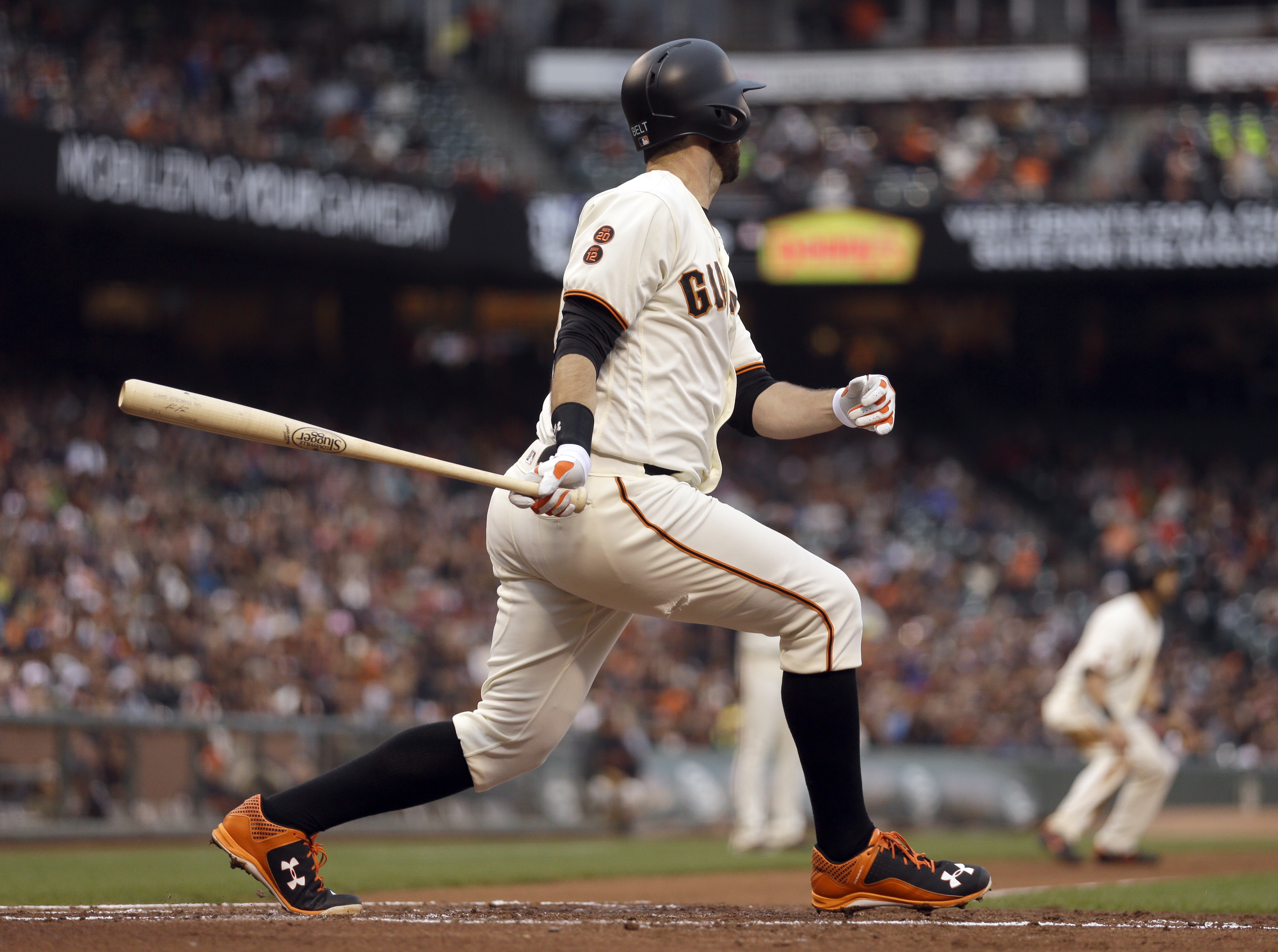 San Francisco Giants' Brandon Belt swings for an RBI single off Colorado Rockies' Tyler Chatwood in the first inning of a baseball game Tuesday, July 5, 2016, in San Francisco. (AP Photo/Ben Margot)
