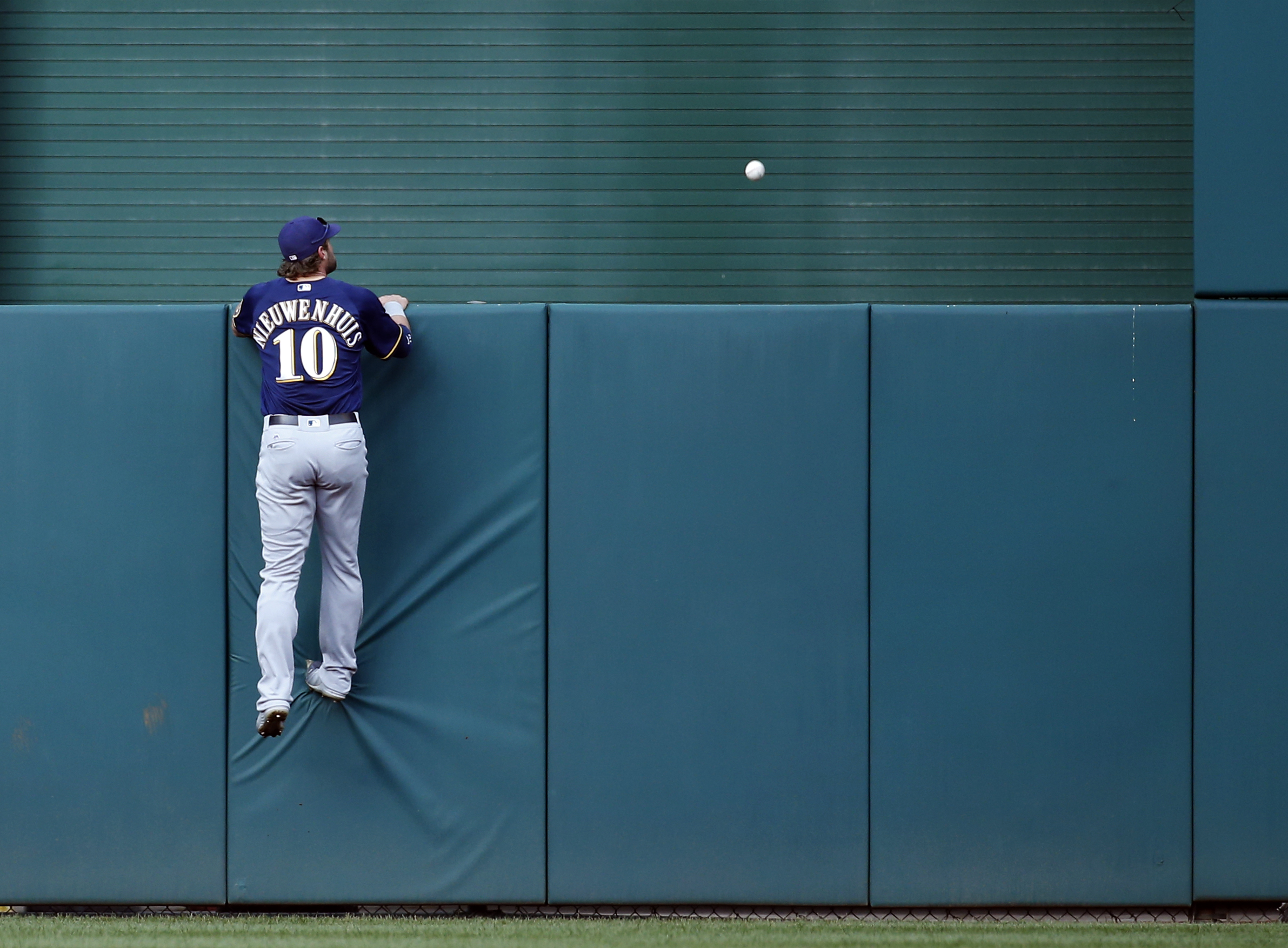 Milwaukee Brewers center fielder Kirk Nieuwenhuis is unable to get to a two-run homer by Washington Nationals' Ryan Zimmerman during the fifth inning of a baseball game at Nationals Park, Wednesday, July 6, 2016, in Washington. (AP Photo/Alex Brandon)