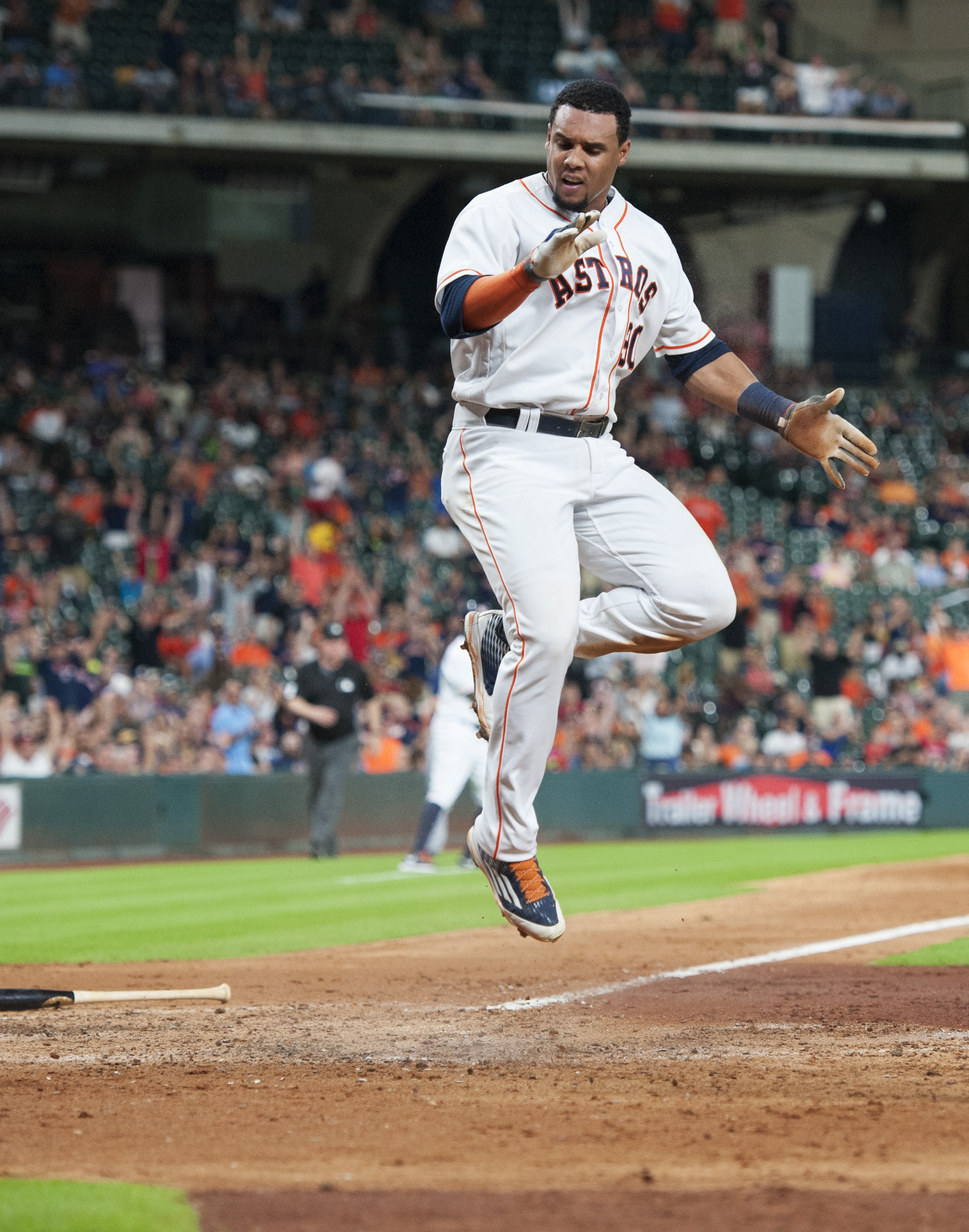 The Houston Astros Carlos Gomez reacts after scoring on a ball hit by Evan Gattis (11) against the Seattle Mariners in the sixth inning of a baseball game Wednesday, July 6, 2016, in Houston. (AP Photo/George Bridges)