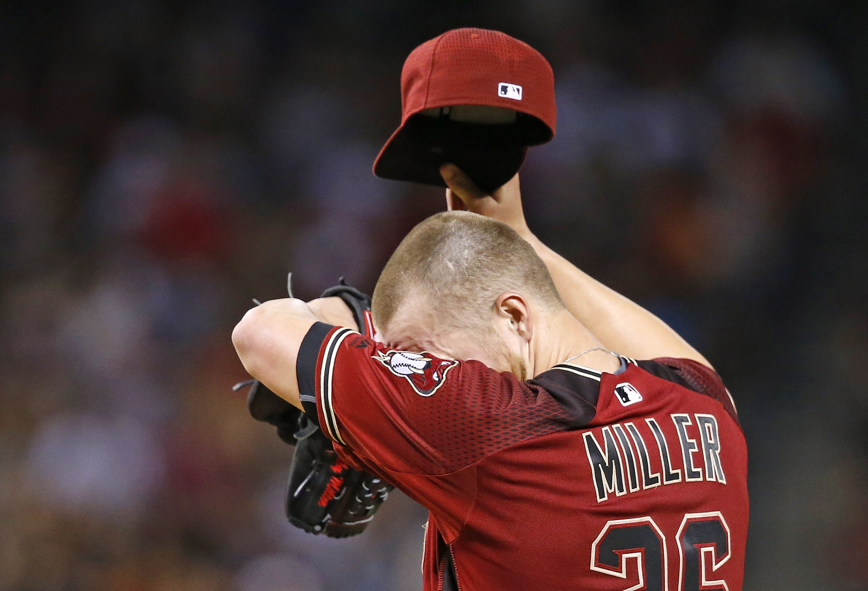 Arizona Diamondbacks' Shelby Miller wipes sweat from his forehead as he struggles, giving up five runs to the San Diego Padres, during the fourth inning of a baseball game Wednesday, July 6, 2016, in Phoenix. (AP Photo/Ross D. Franklin)