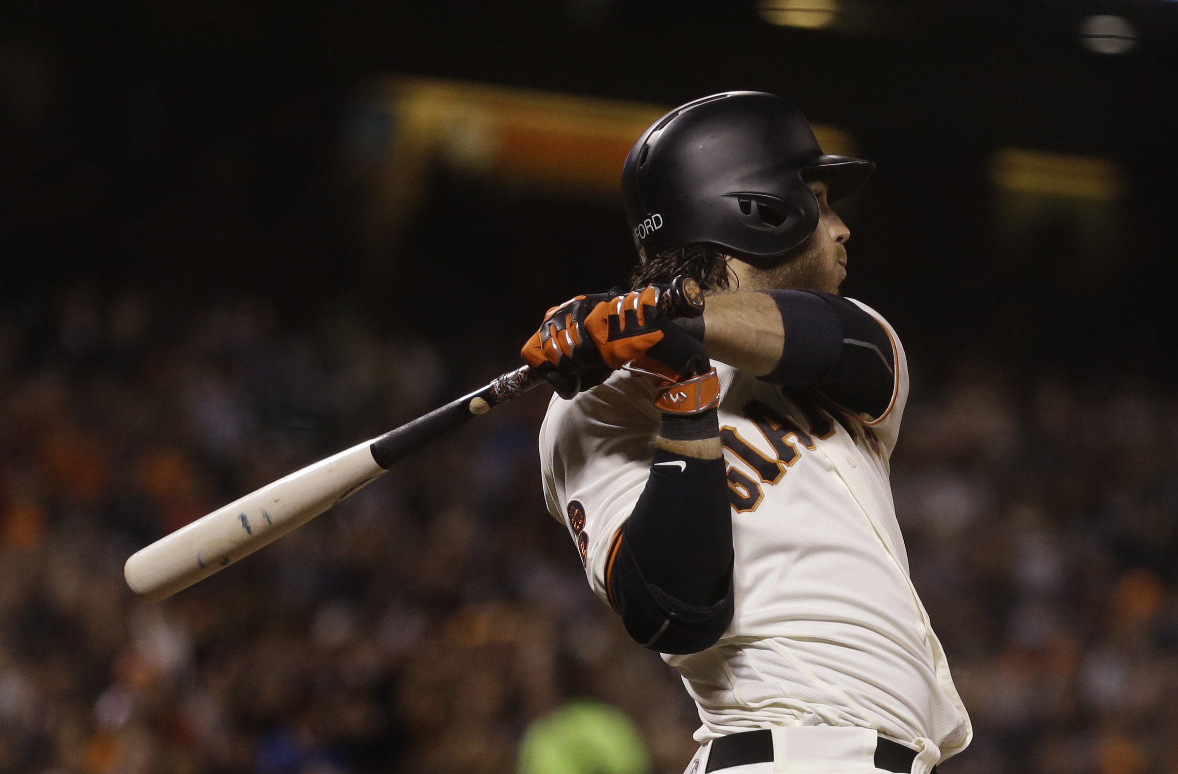 San Francisco Giants' Brandon Crawford swings for an RBI sacrifice fly off Colorado Rockies' Gonzalez Germen in the eighth inning of a baseball game Wednesday, July 6, 2016, in San Francisco. (AP Photo/Ben Margot)