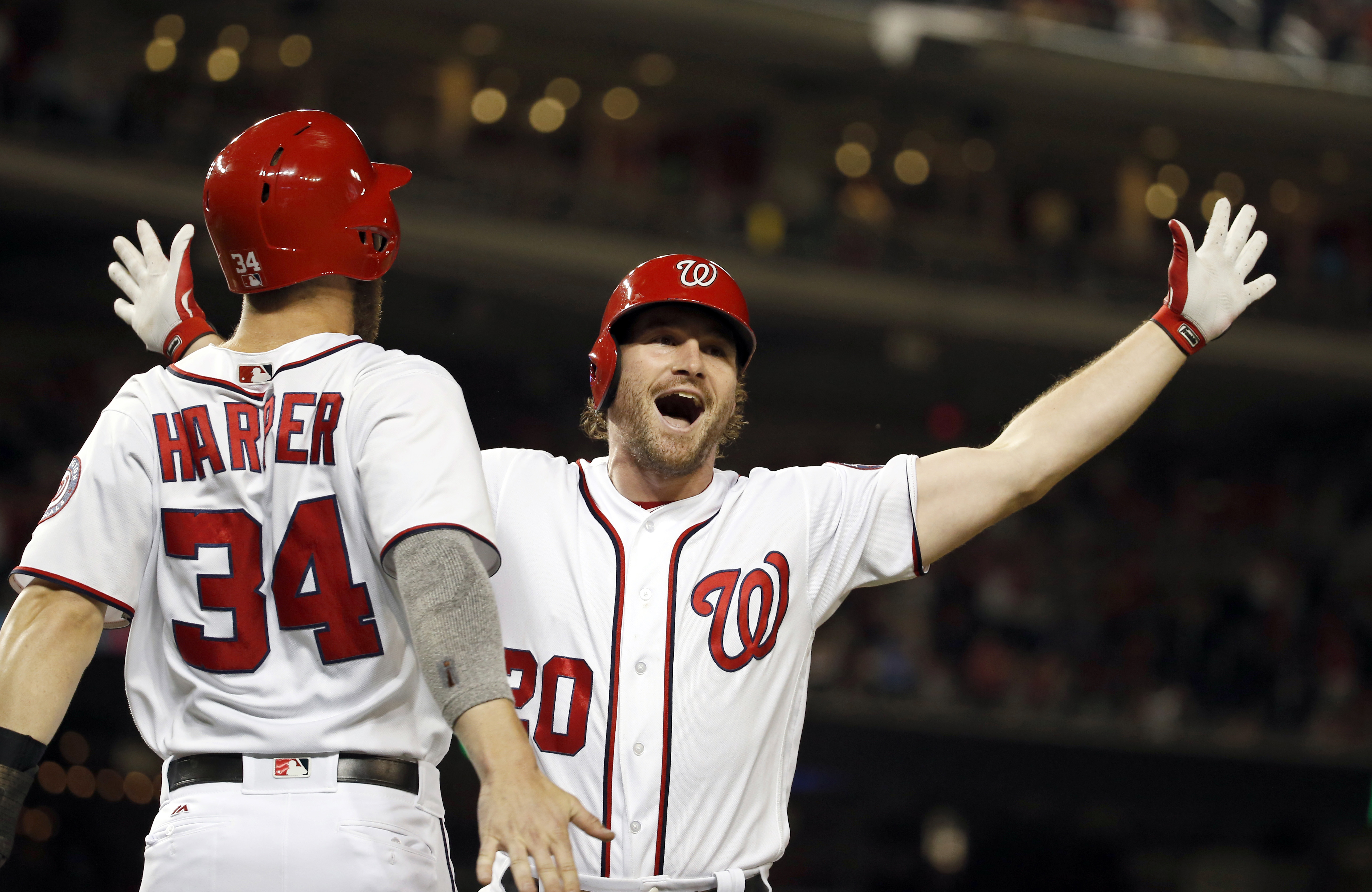 FILE - In this June 29, 2016, file photo, Washington Nationals' Bryce Harper (34) celebrates with Daniel Murphy (20) after Murphy's two-run homer in the eighth inning of a baseball game against the New York Mets at Nationals Park in Washington. Texas' Ian