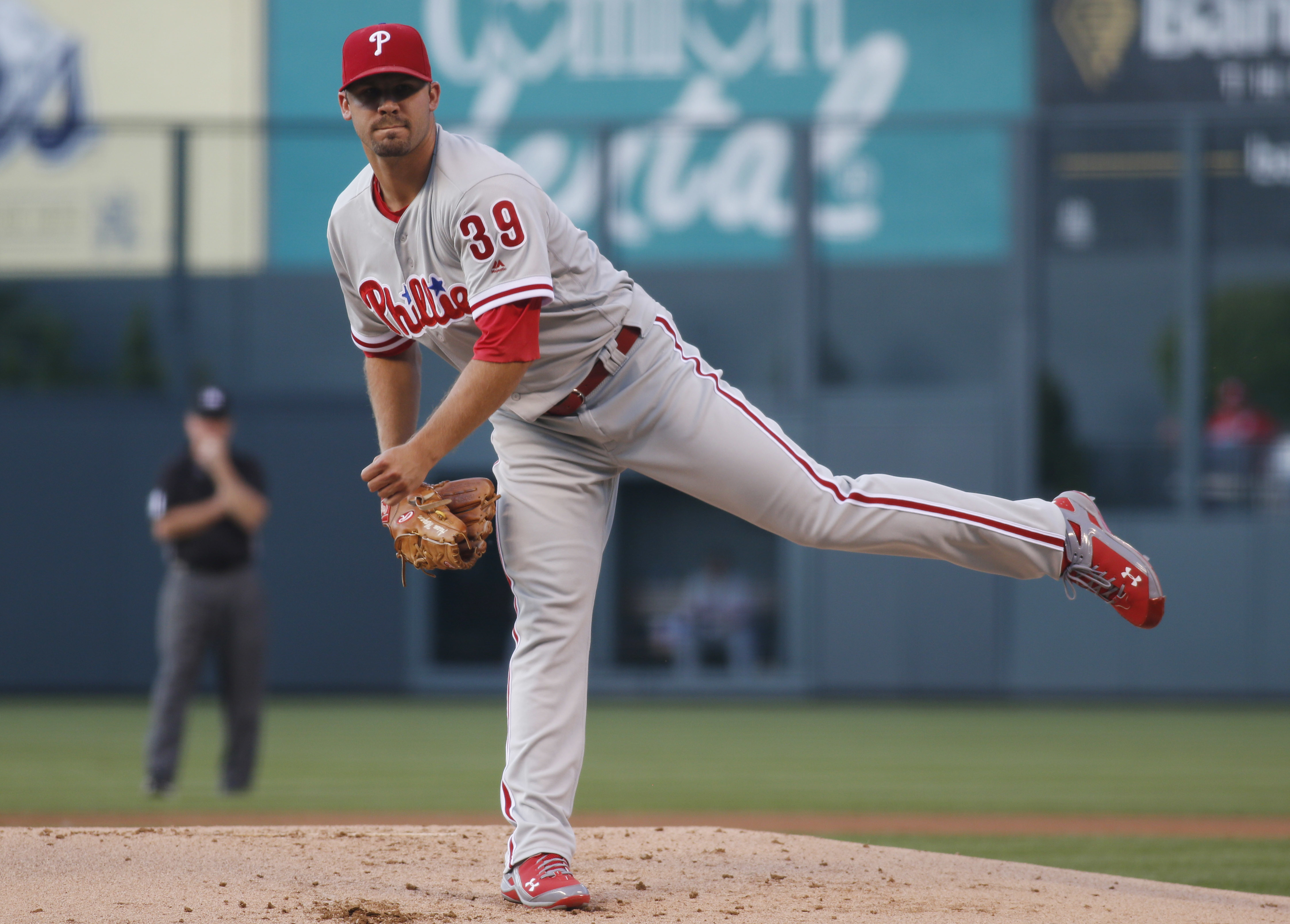 Philadelphia Phillies starting pitcher Adam Morgan delivers a pitch to Colorado Rockies' Trevor Story in the first inning of a baseball game Thursday, July 7, 2016, in Denver. (AP Photo/David Zalubowski)
