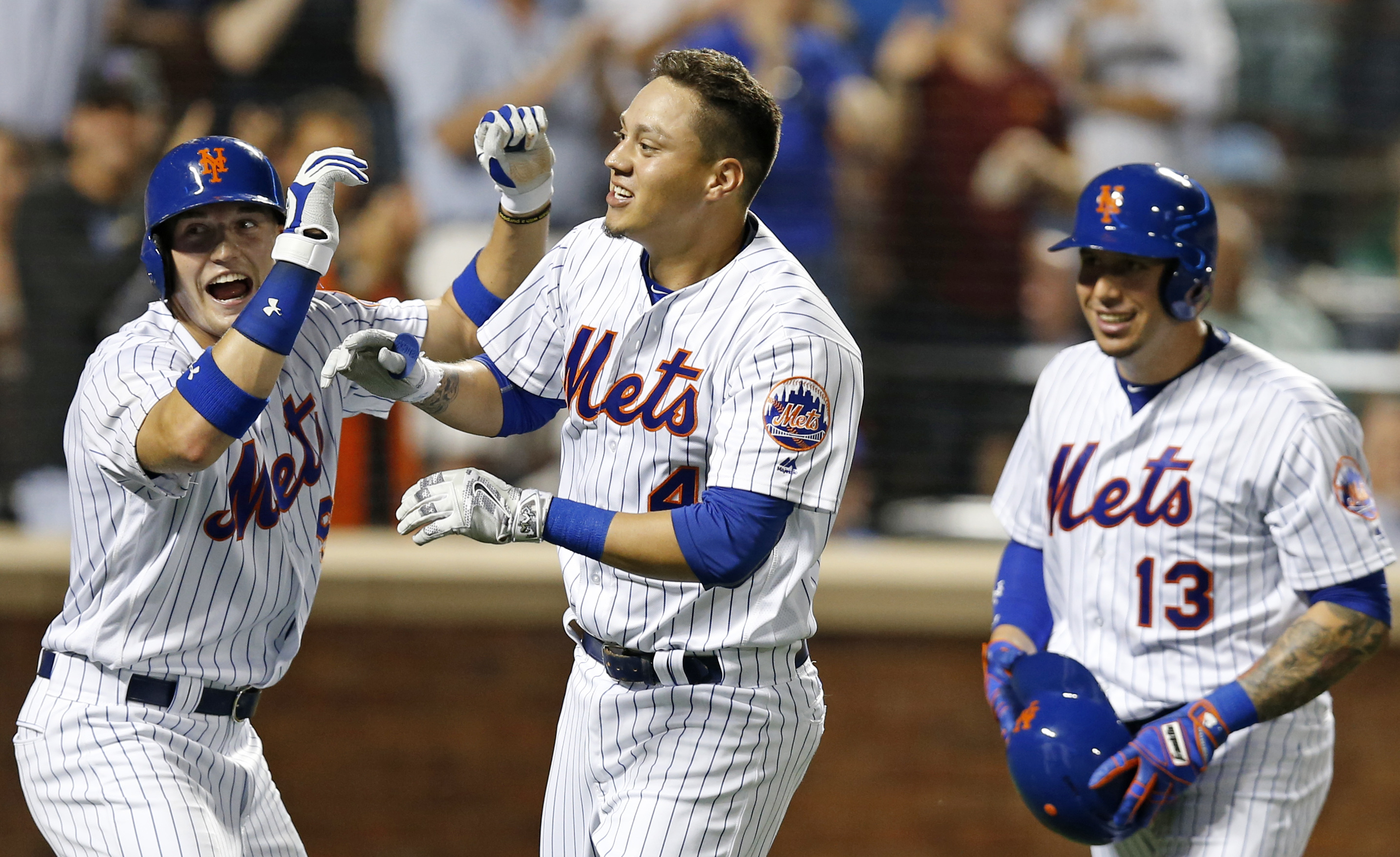 New York Mets left fielder Brandon Nimmo (9), Mets Wilmer Flores (4) and Mets Asdrubal Cabrera celebrate after Nimmo and Cabrera scored on Flores's pinch-hit, three-run, home run during the fifth inning of a baseball game against the Washington Nationals,