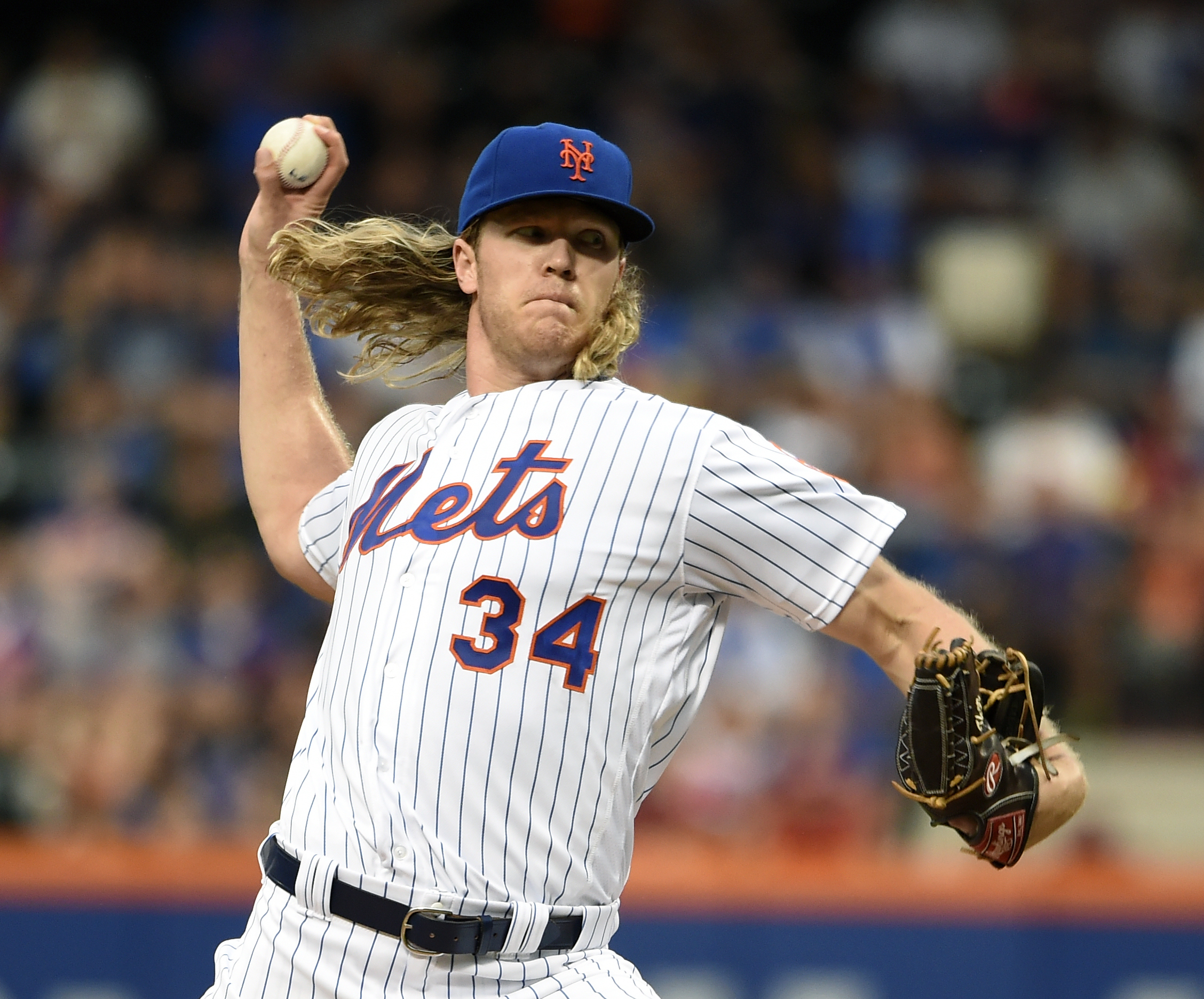 New York Mets starter Noah Syndergaard pitches against the Washington Nationals in the first inning of a baseball game, Friday, July 8, 2016, in New York. (AP Photo/Kathy Kmonicek)