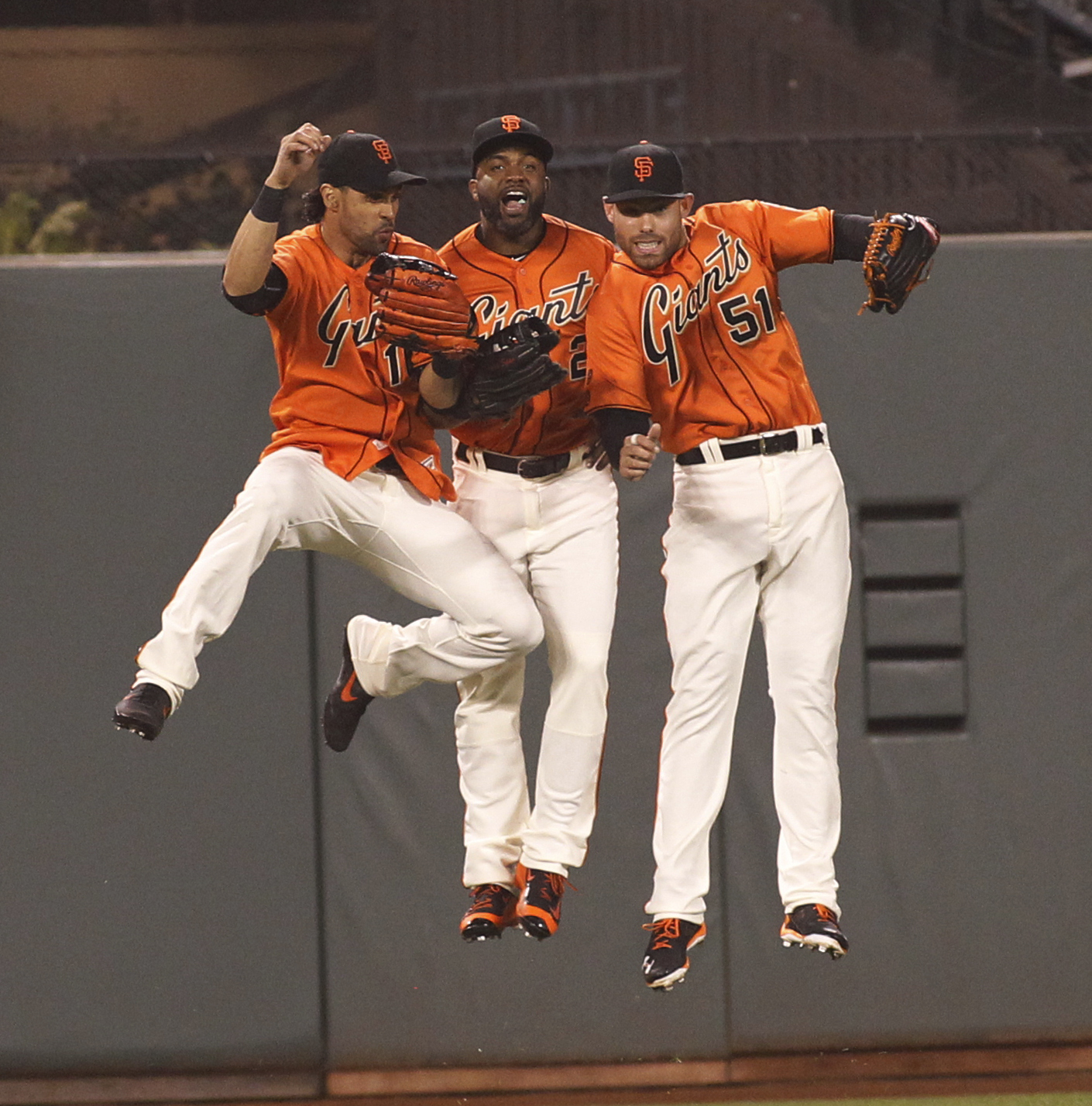 San Francisco Giants outfielders, from left, Angel Pagan, Denard Span and Mac Williamson jump after the team's baseball game against the Arizona Diamondbacks, Friday, July 8, 2016, in San Francisco. The Giants won 6-2. (AP Photo/George Nikitin)