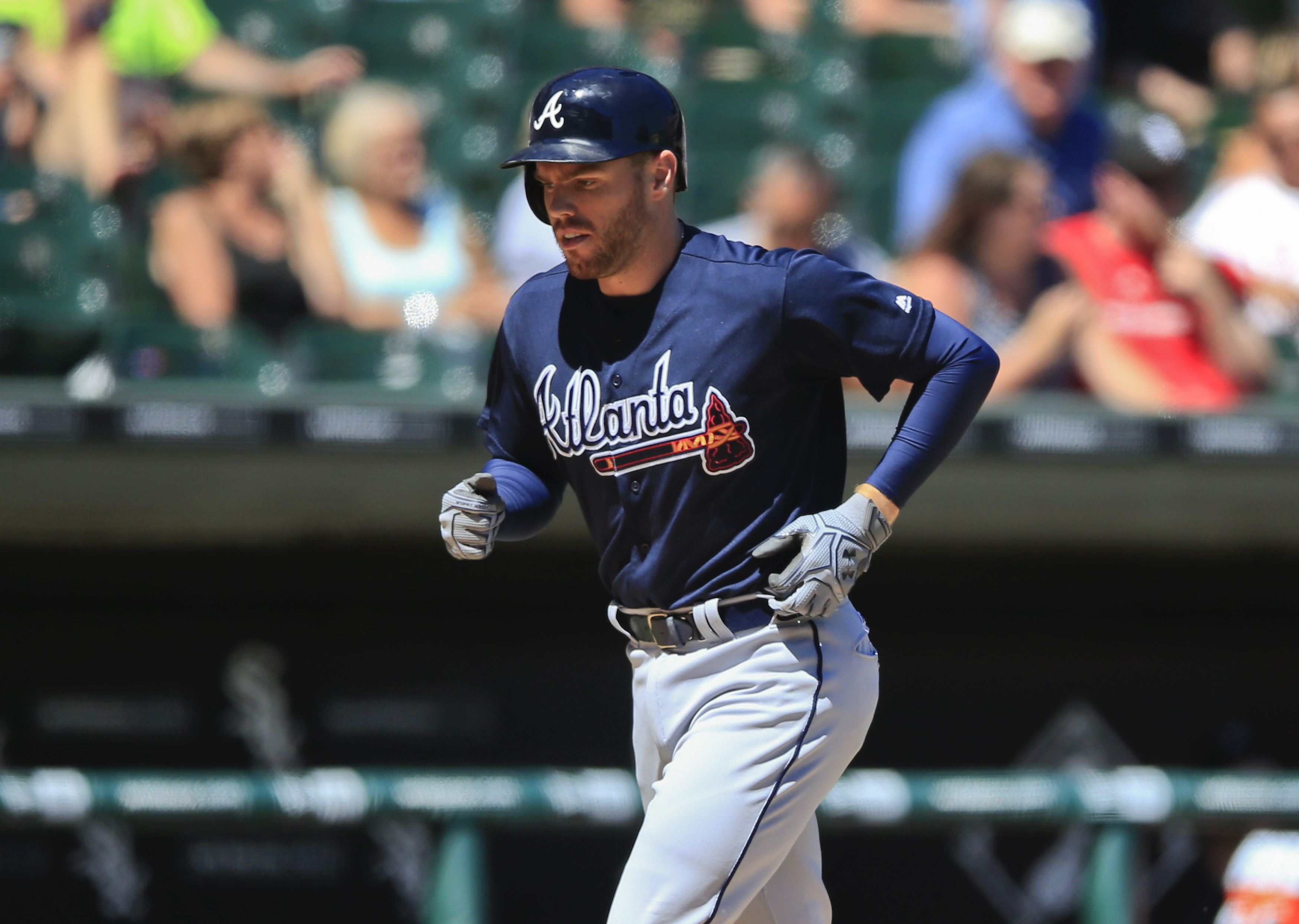 Atlanta Braves' Freddie Freeman runs the bases after hitting a solo home run during the sixth inning of a baseball game against the Chicago White Sox, Saturday, July 9, 2016, in Chicago. (AP Photo/Kamil Krzaczynski)