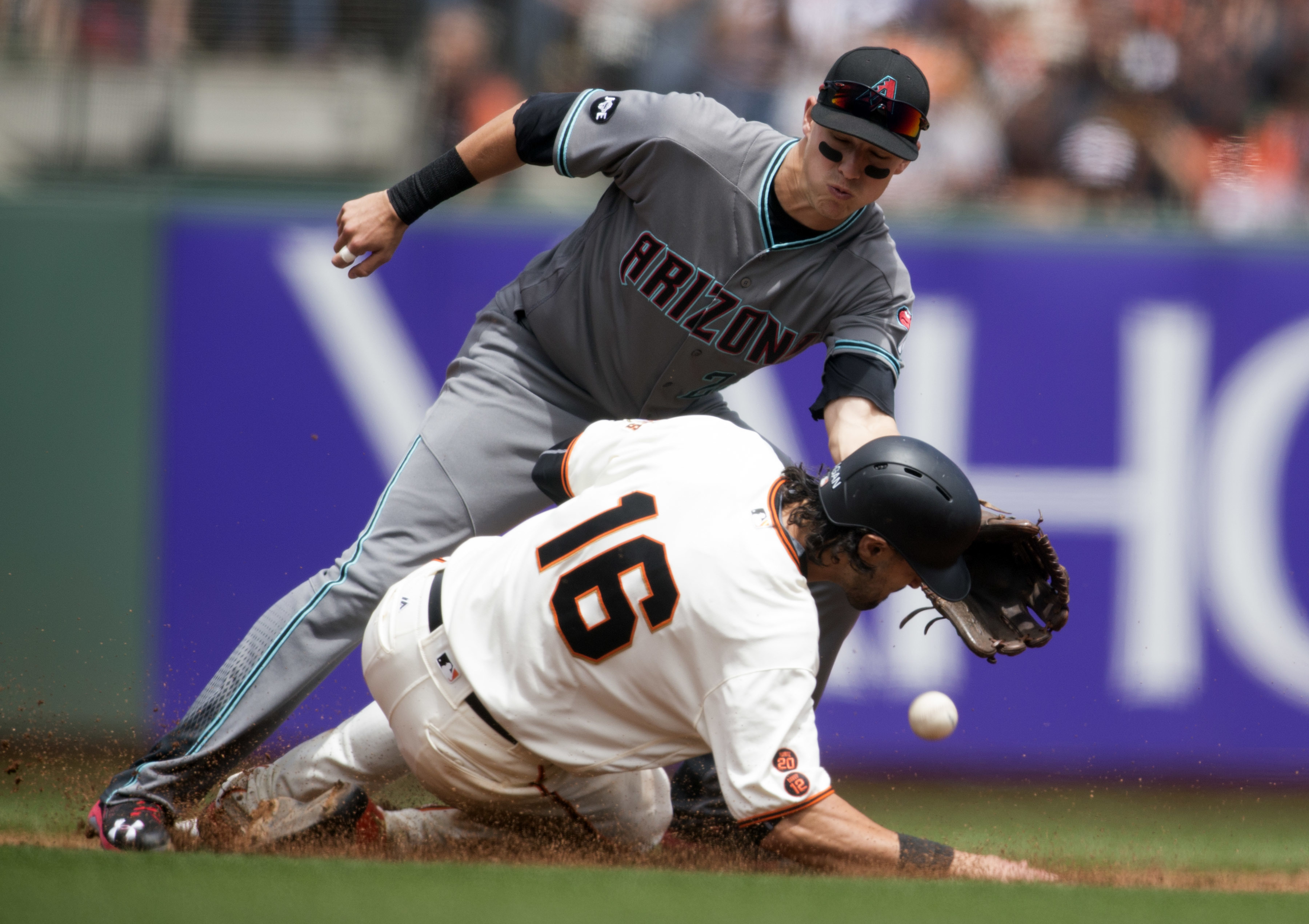 San Francisco Giants' Angel Pagan is struck by the relay throw intended for Arizona Diamondbacks' Nick Ahmed as Pagan steals second base during the third inning of baseball game on Saturday, July 9, 2016, in San Francisco. (AP Photo/D. Ross Cameron)