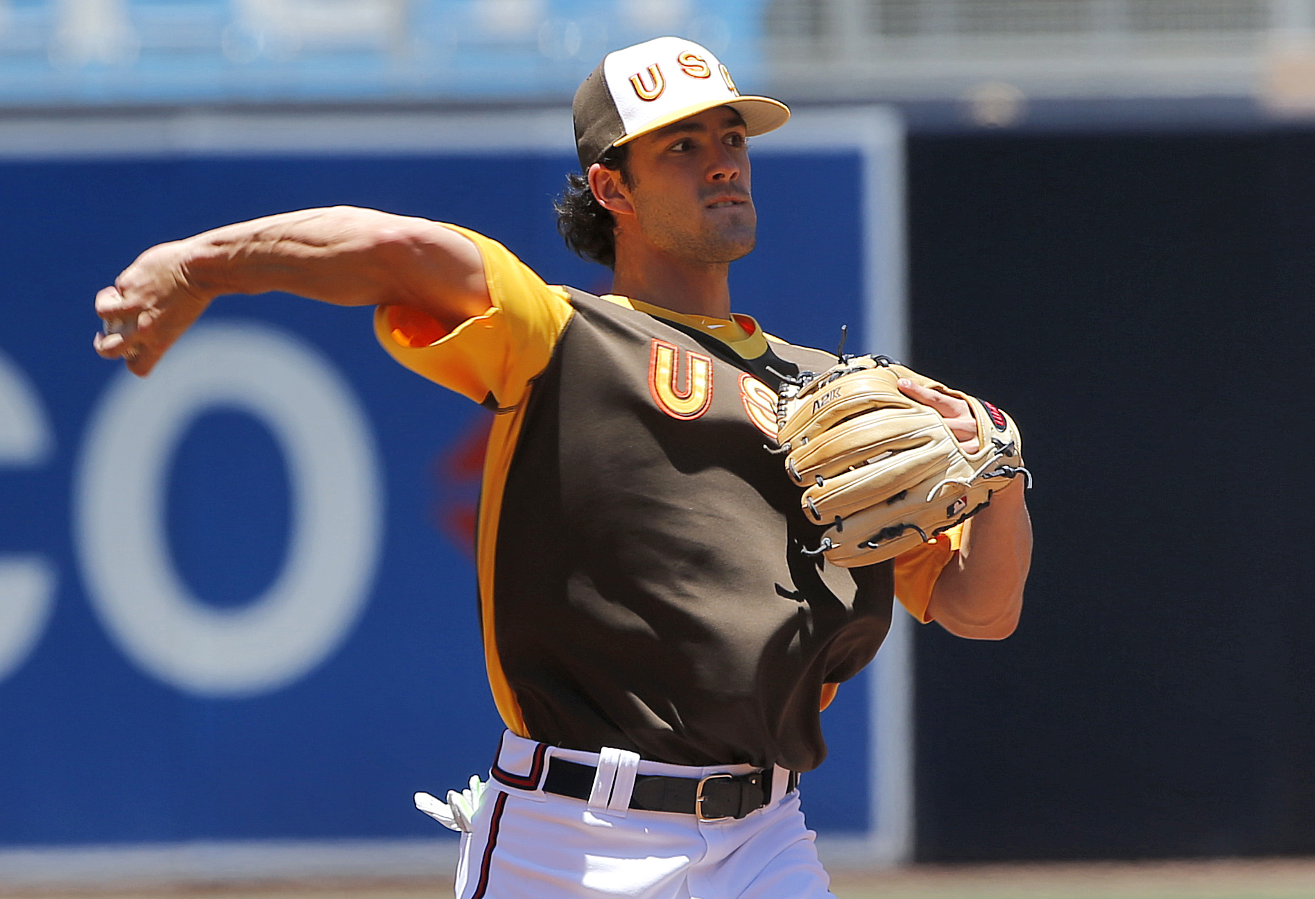 U.S team's Dansby Swanson, of the Atlanta Braves, warms up prior to the All-Star Futures baseball game against the World team, Sunday, July 10, 2016, in San Diego. (AP Photo/Lenny Ignelzi)