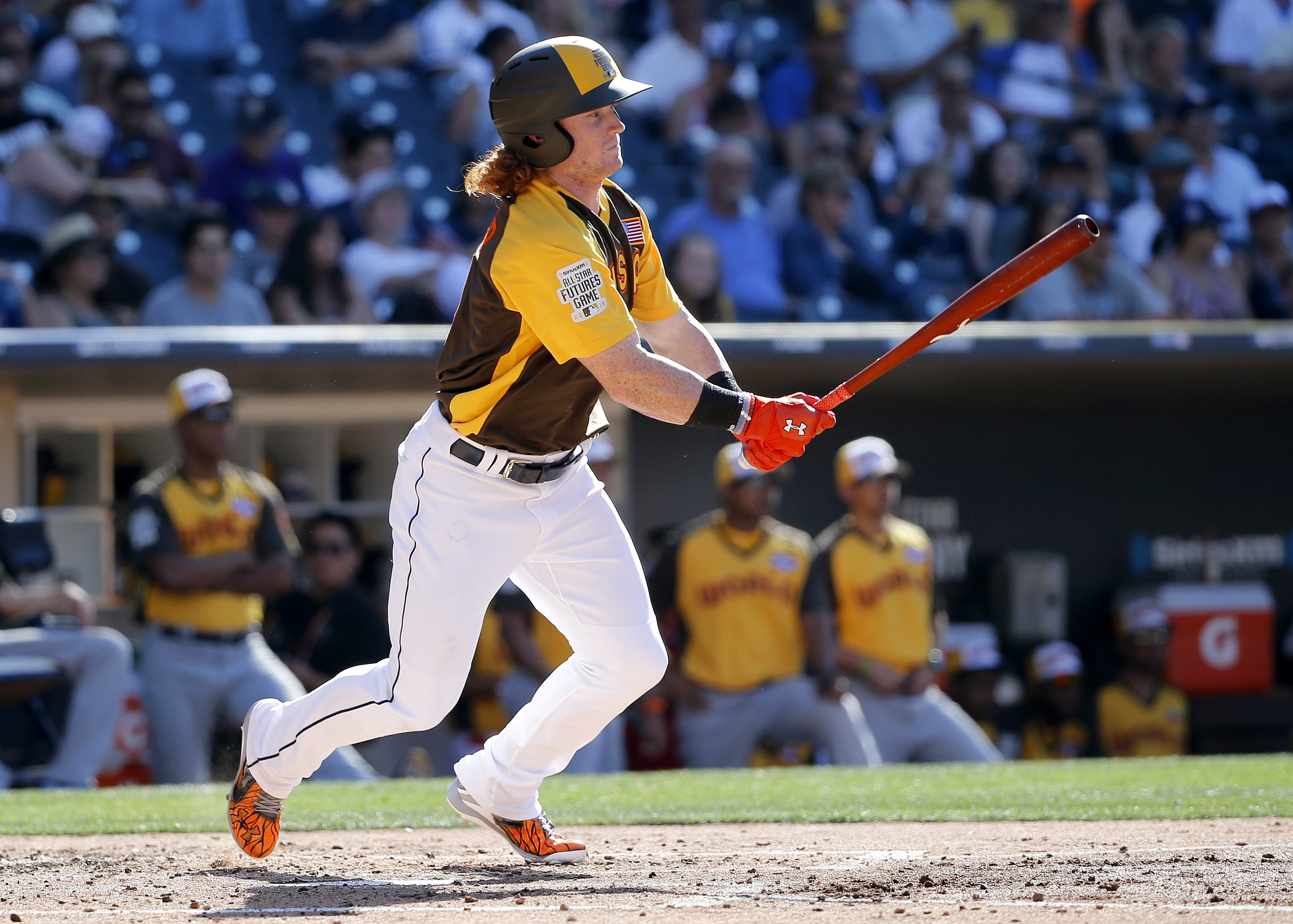 U.S. Team's Clint Frazier, of the Cleveland Indians, follows through on an RBI-base hit during the third inning of the All-Star Futures baseball game against the World Team, Sunday, July 10, 2016, in San Diego. (AP Photo/Lenny Ignelzi)