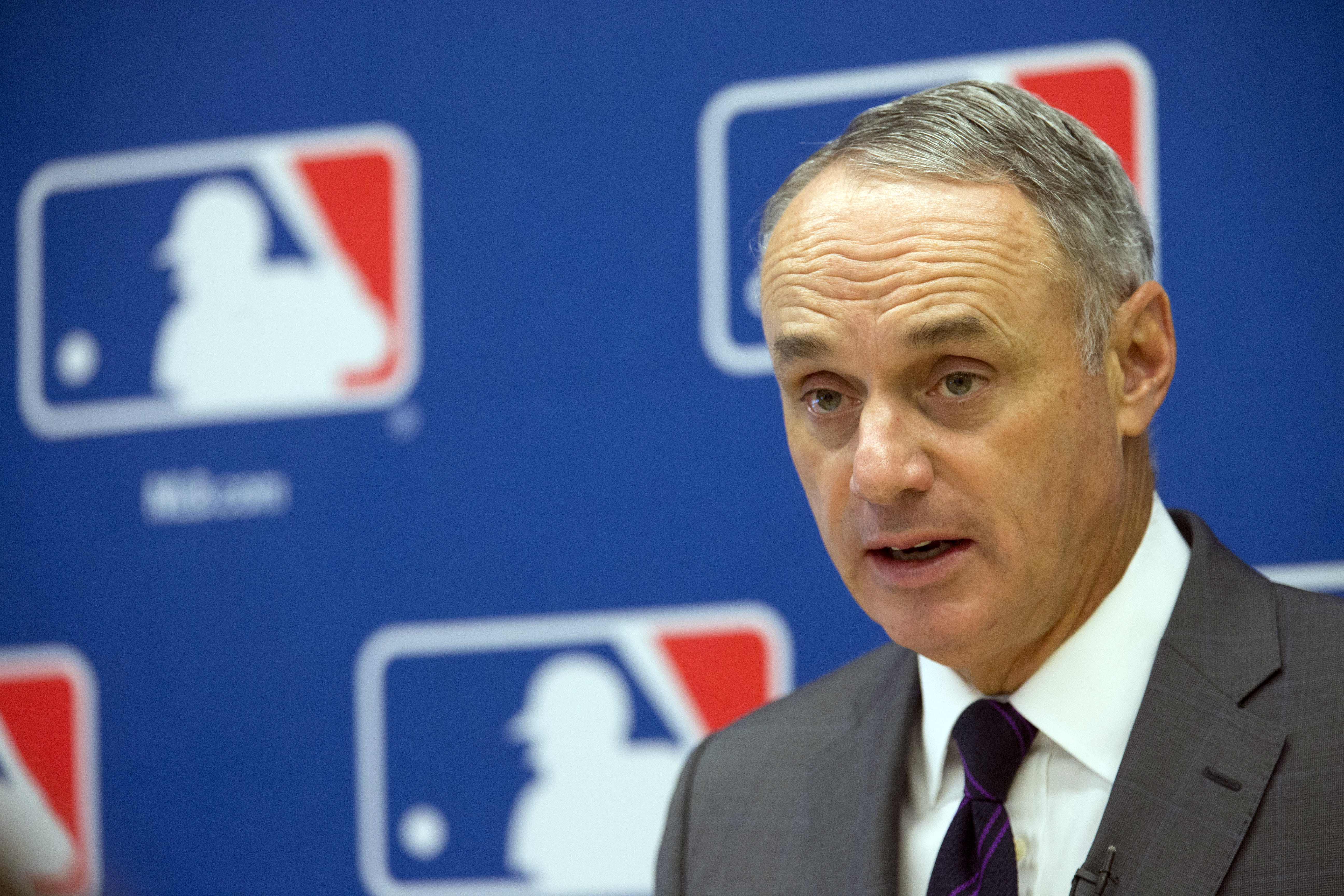 FILE - In this May 19, 2016, file photo, baseball Commissioner Rob Manfred speaks to reporters during a news conference at Major League Baseball headquarters in New York. With home runs up to a level not seen since the height of the Steroids Era, Manfred