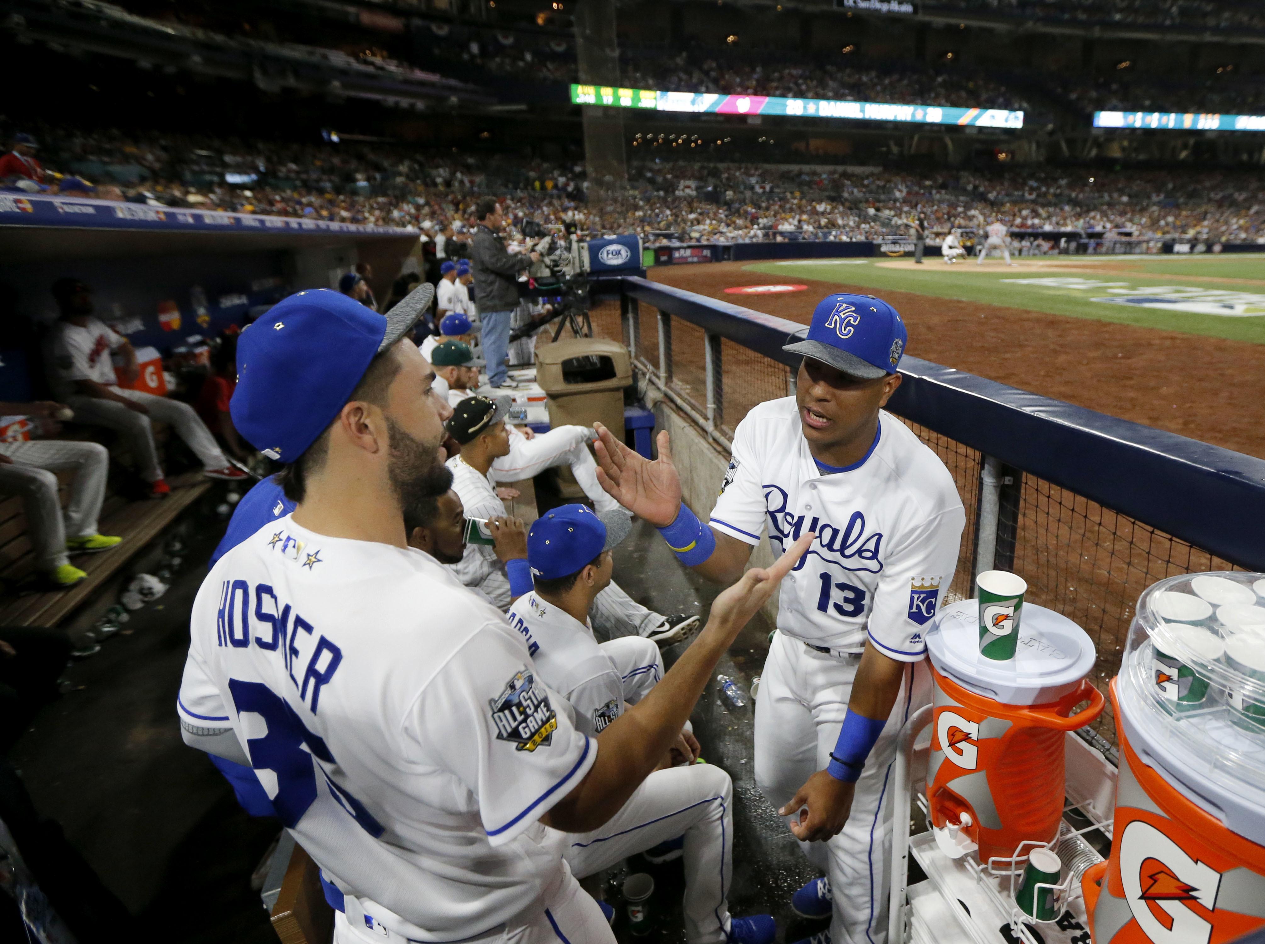 American League's Salvador Perez, of the Kansas City Royals, congratulates teammate Eric Hosmer, of the Kansas City Royals, for Hosmer's MVP award in the MLB baseball All-Star Game, Tuesday, July 12, 2016, in San Diego. The American League won 4-2. (AP Ph