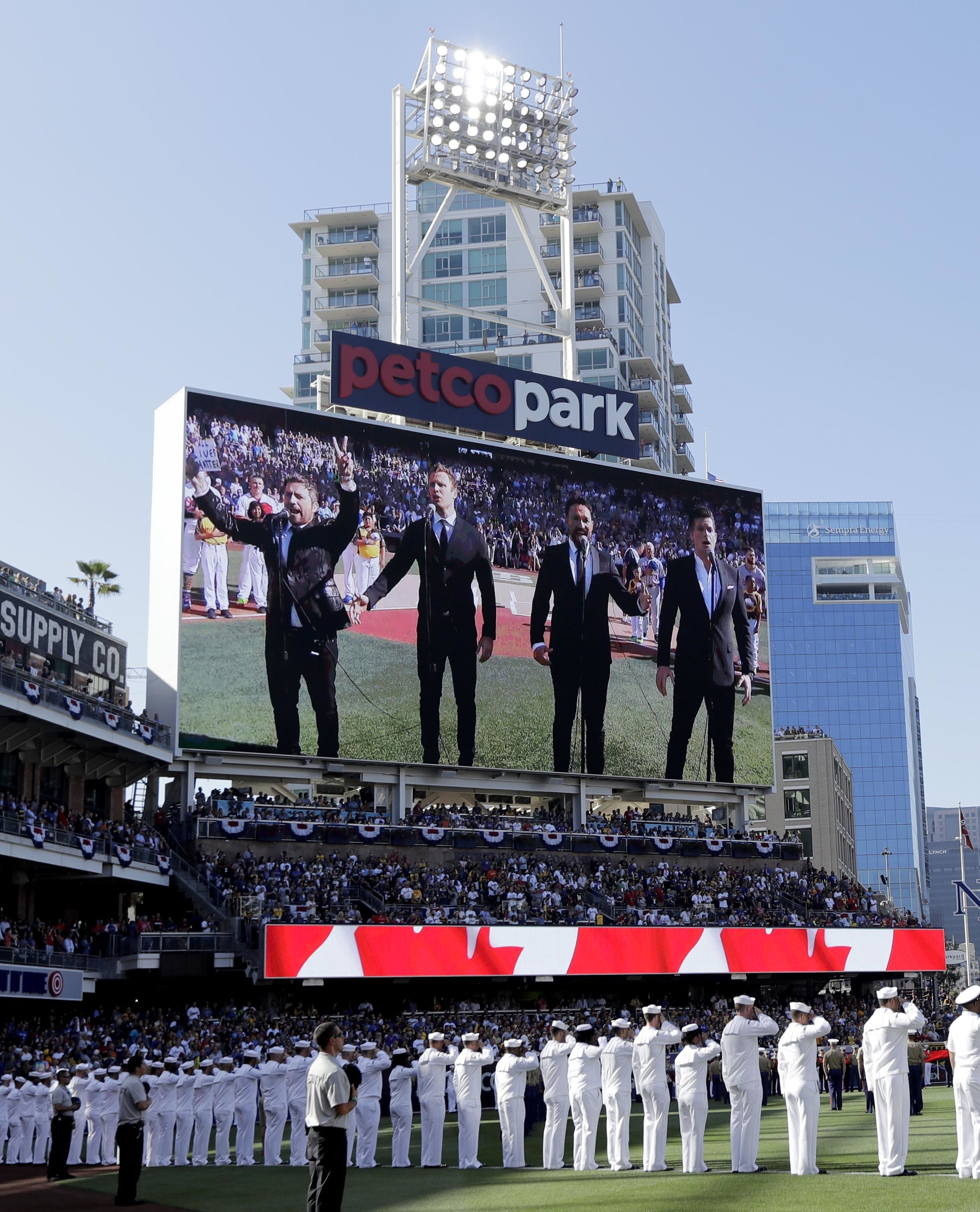 FILE - In this Tuesday, July 12, 2016 file photo, The Tenors, shown on the scoreboard, perform during the Canadian National Anthem prior to the MLB baseball All-Star Game, in San Diego. A member of a Canadian singing quartet changed a lyric in his country