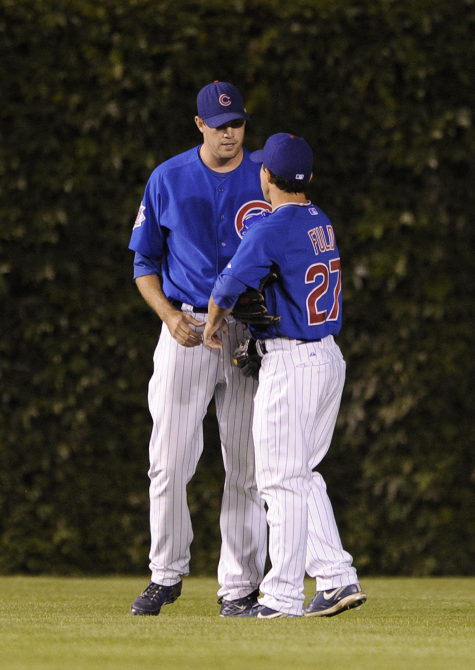 FILE - In this July 12, 2009, file photo, Chicago Cubs pitcher Sean Marshall left, talks with center fielder Sam Fuld after manager Lou Piniella put Marshall in left field in the ninth inning of the second game of a baseball doubleheader against the St. L