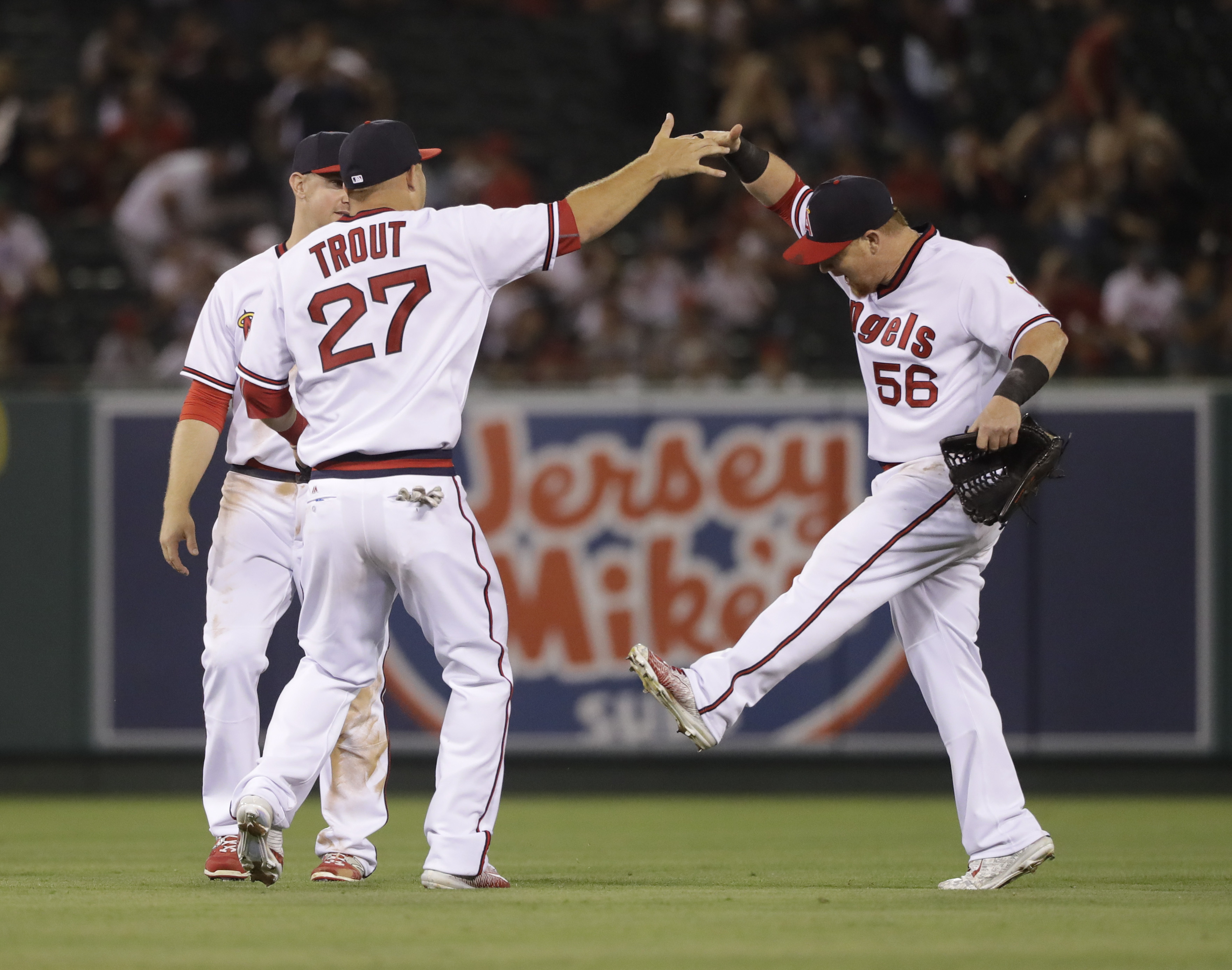 Los Angeles Angels' Mike Trout, left, and Kole Calhoun, right, celebrate the team's 7-0 win over the Chicago White Sox in a baseball game, Friday, July 15, 2016, in Anaheim, Calif. (AP Photo/Jae C. Hong)