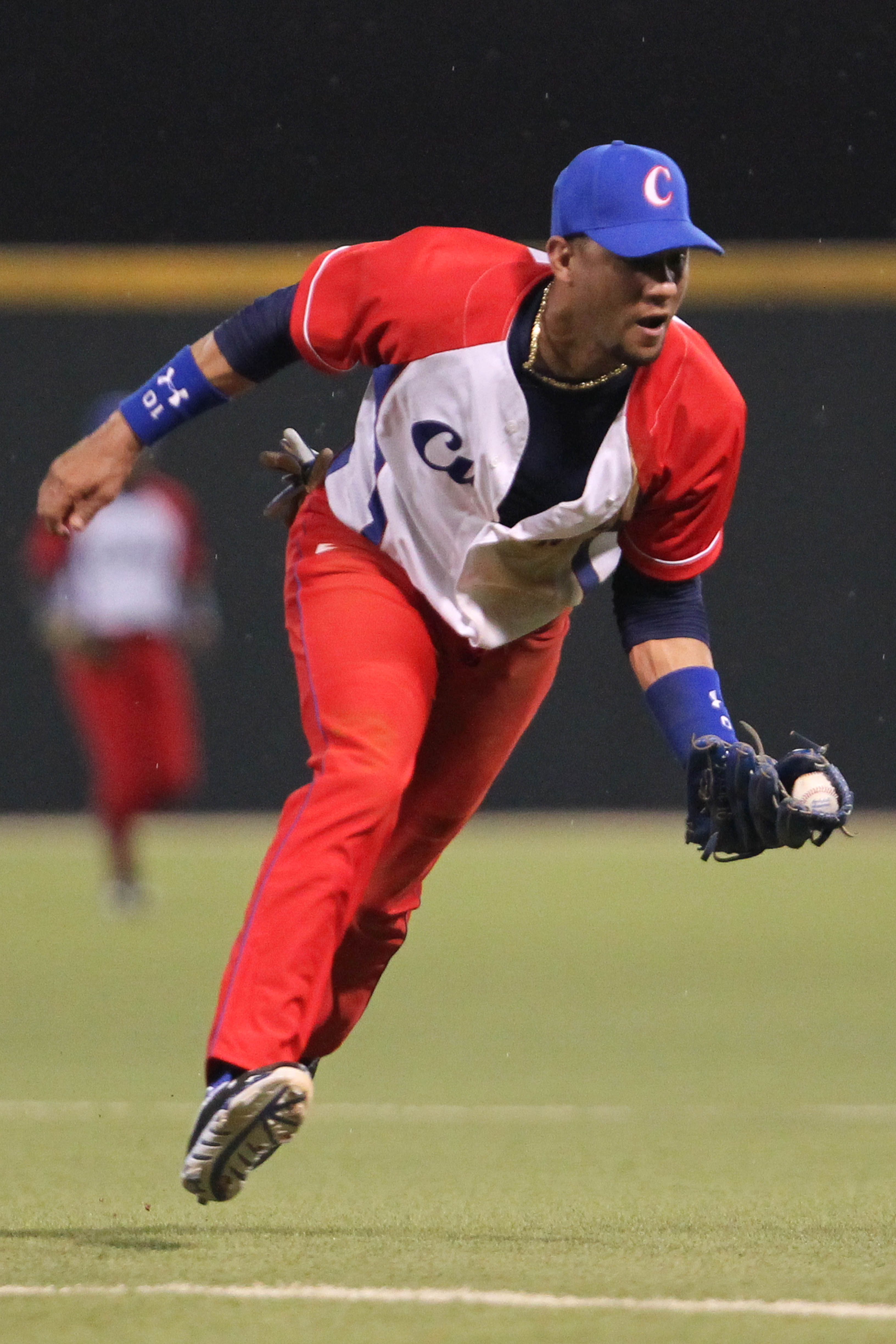Cuba second baseman Yulieski Gurriel fields a ground ball during a Caribbean Series baseball game against Puerto Rico in San Juan, Puerto Rico, Wednesday, Feb. 4, 2015. (AP Photo/Ricardo Arduengo)
