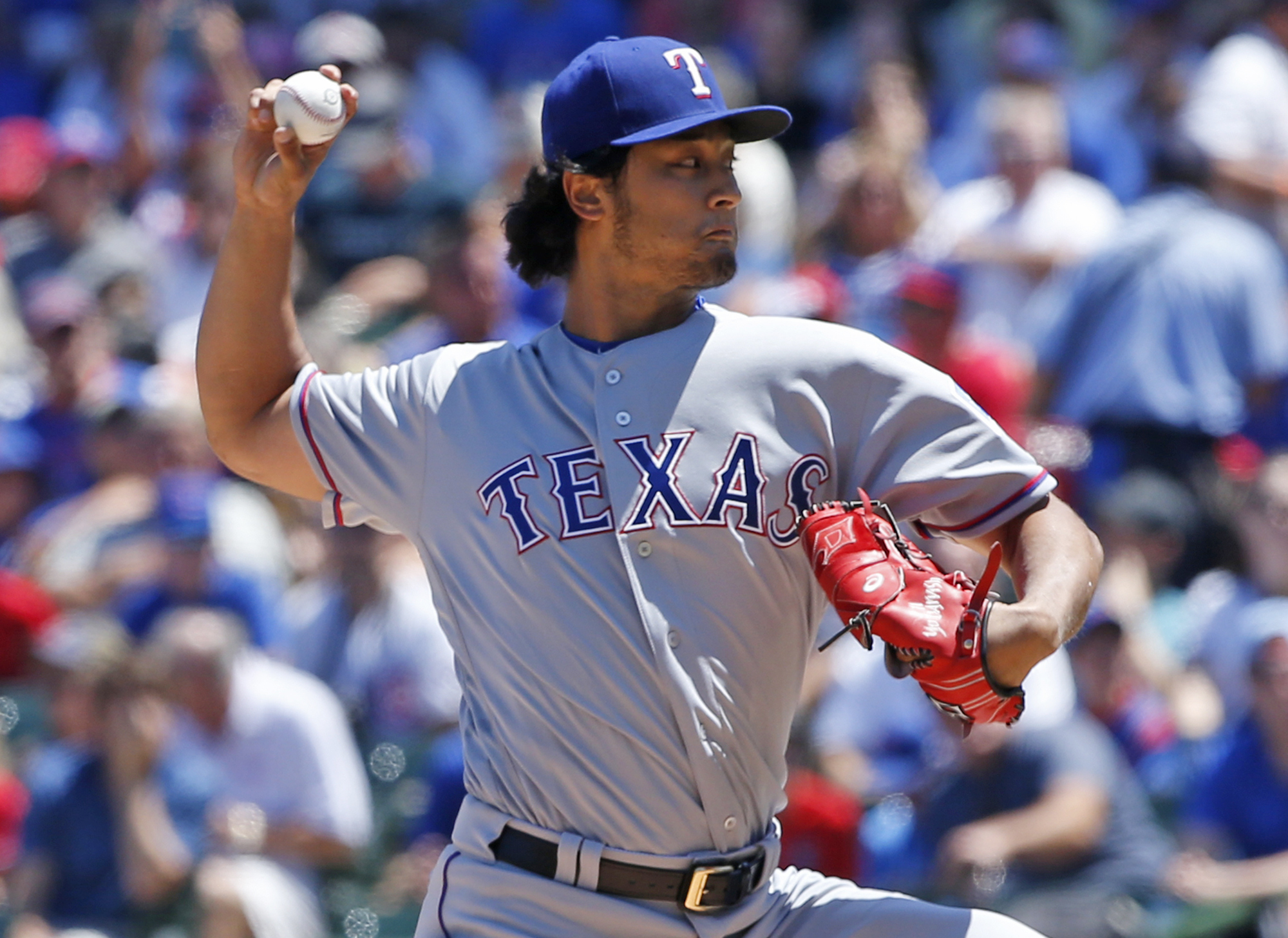 Texas Rangers starter Yu Darvish, of Japan, throws against the Chicago Cubs during the first inning of an interleague baseball game in Chicago, Saturday, July 16, 2016. (AP Photo/Nam Y. Huh)