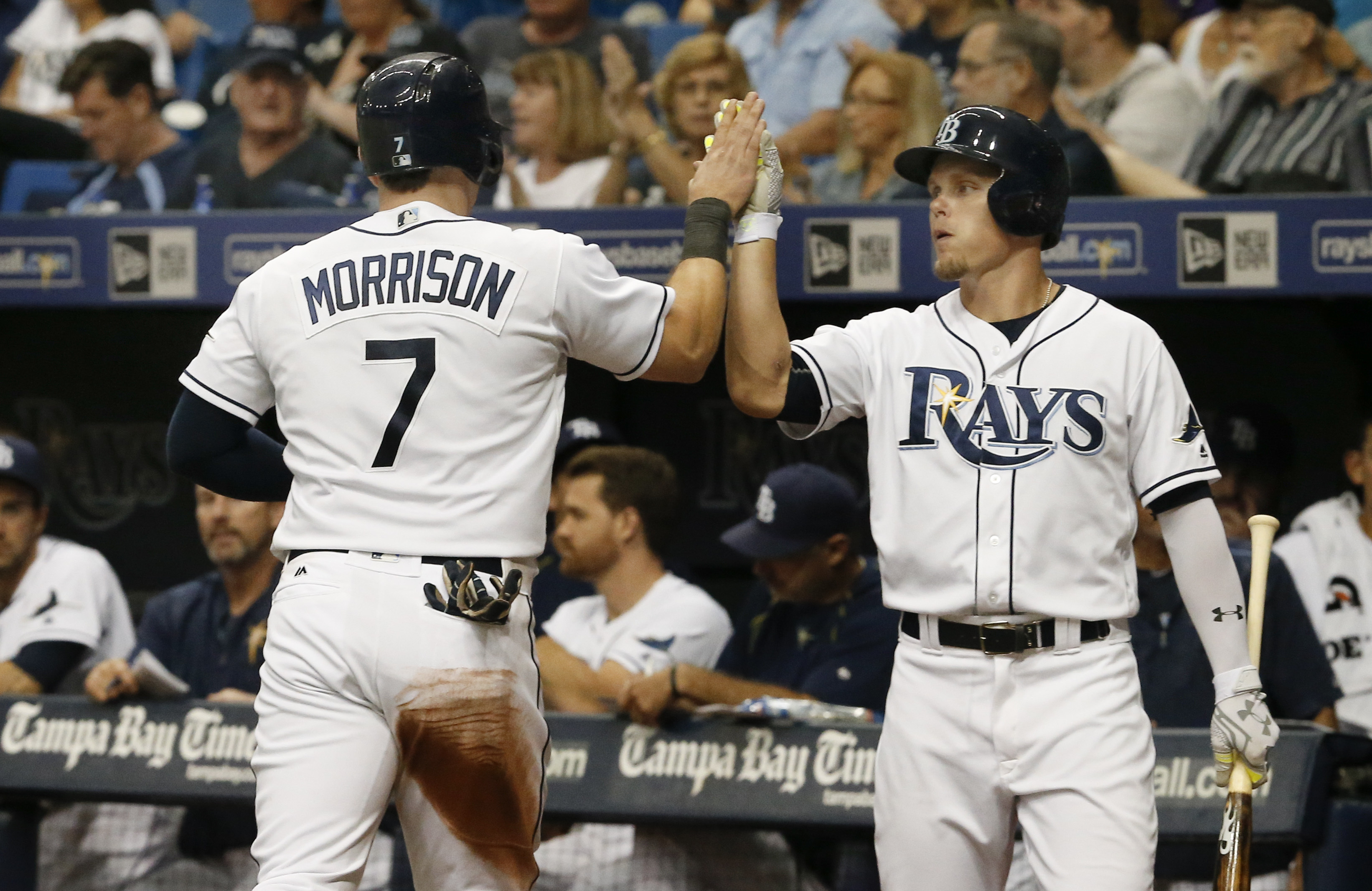 Tampa Bay Rays center fielder Brandon Guyer congratulates Logan Morrison (7) who scored a run during the fourth inning of a baseball game against the Baltimore Orioles, Saturday, July 16, 2016, in St. Petersburg, Fla. (AP Photo/Reinhold Matay)