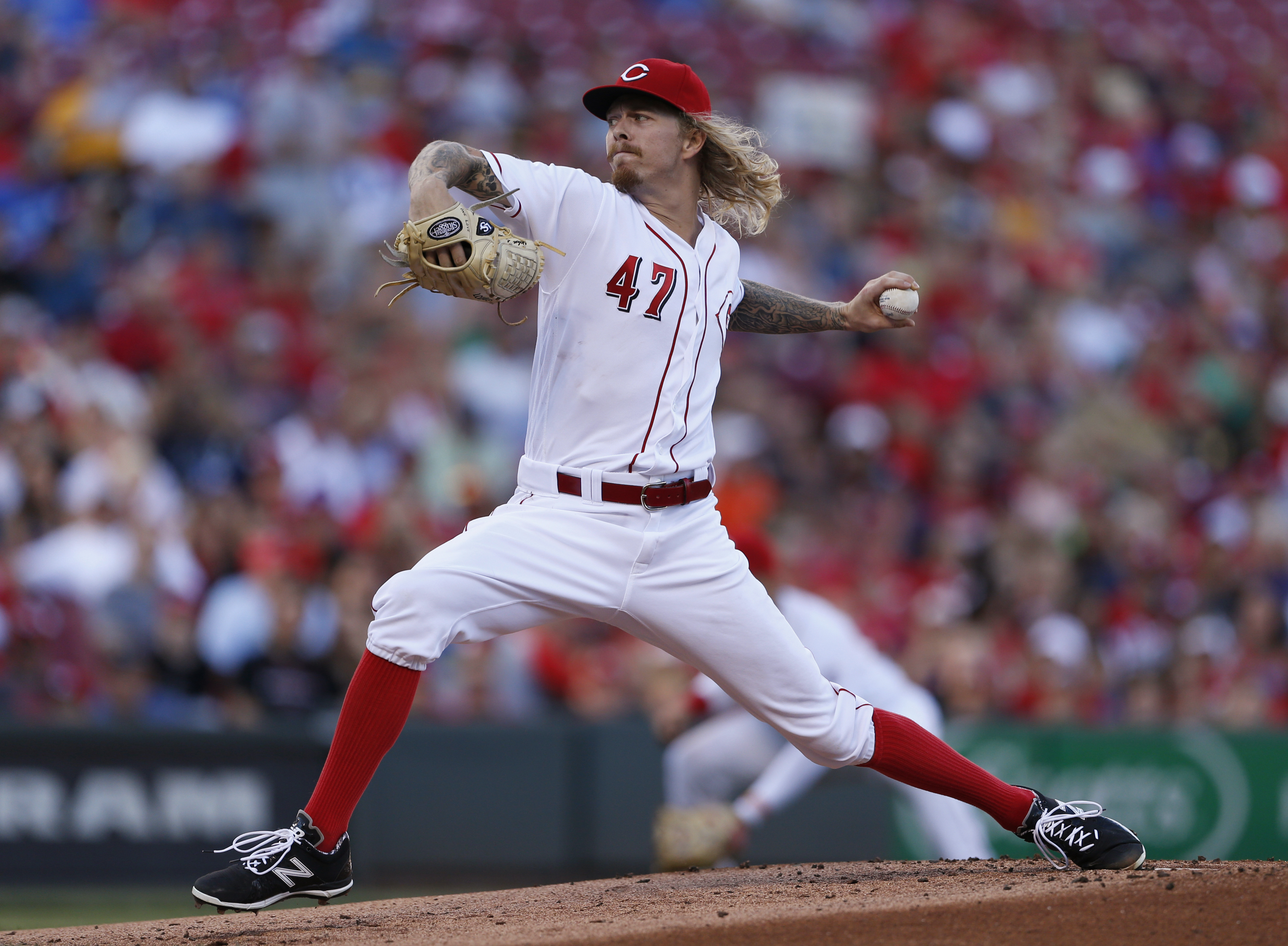 Cincinnati Reds starting pitcher John Lamb throws against the Milwaukee Brewers during the first inning of a baseball game, Saturday, July 16, 2016, in Cincinnati. (AP Photo/Gary Landers)