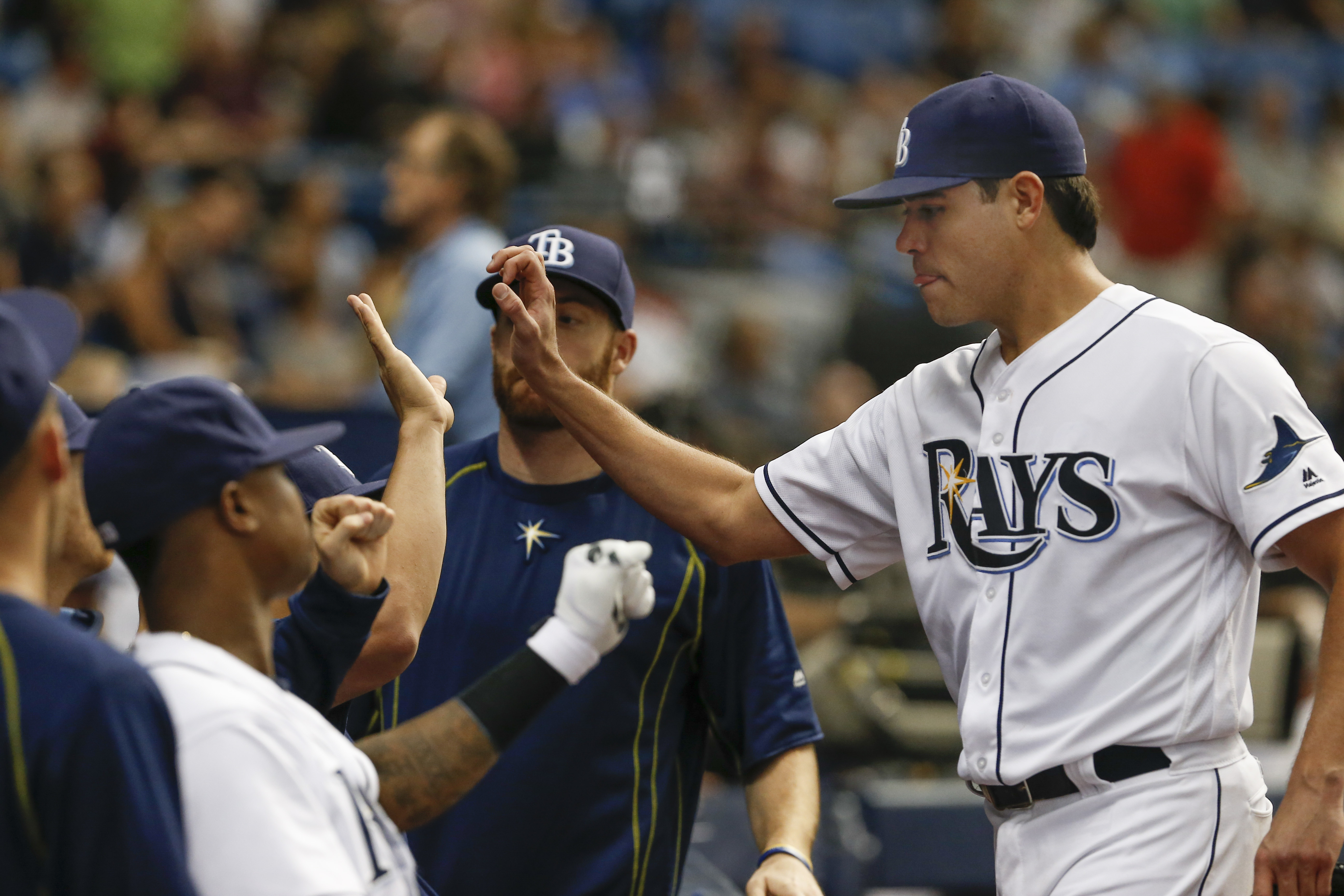 Tampa Bay Rays starting pitcher Matt Moore, right, gets congratulations from teammates during the sixth inning of a baseball game against the Baltimore Orioles, Saturday, July 16, 2016, in St. Petersburg, Fla. (AP Photo/Reinhold Matay)